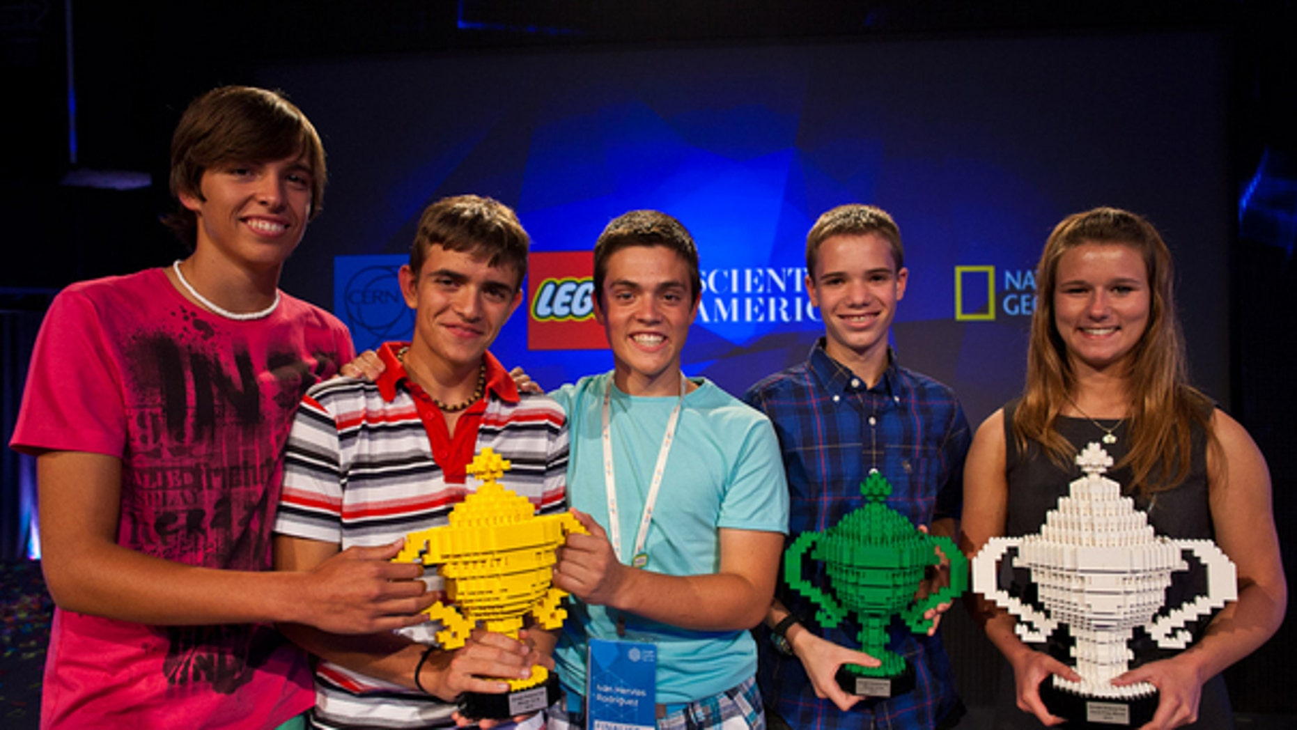 Google Science Fair grand prize winner Brittany Wenger (far right) shares the stage with other winners in their age categories