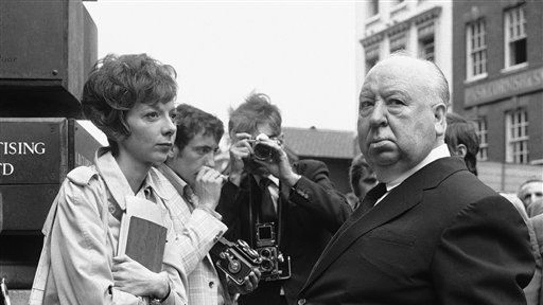 """In this July 26, 1971 file photo, British film producer and director Alfred Hitchcock, right, discusses filming with actress Anna Massey, one of the stars of """"Frenzy"""", in Covent Garden Market, London."""