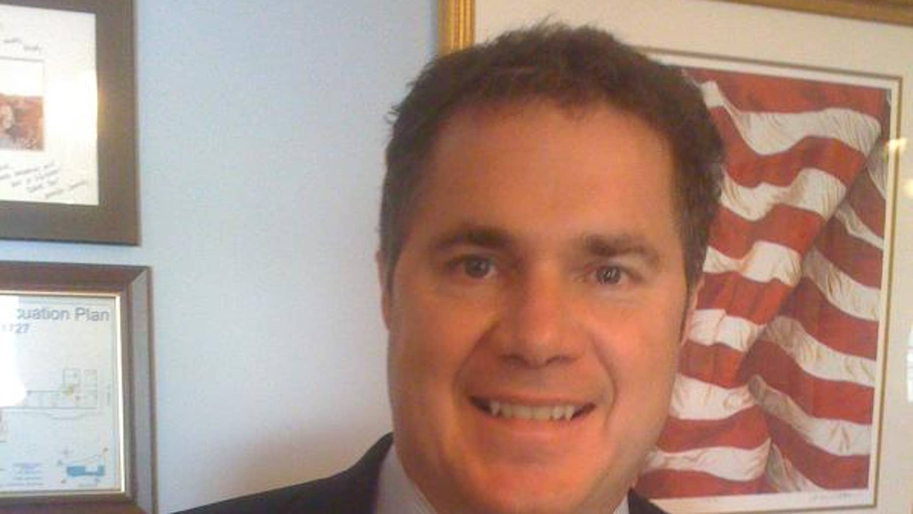 Rep. Bruce Braley, D-Iowa, wears one a button supporting Rep. Debbie Wasserman Schultz in this photo posted to his Twitter account.  (Rep. Burce Braley Photo)