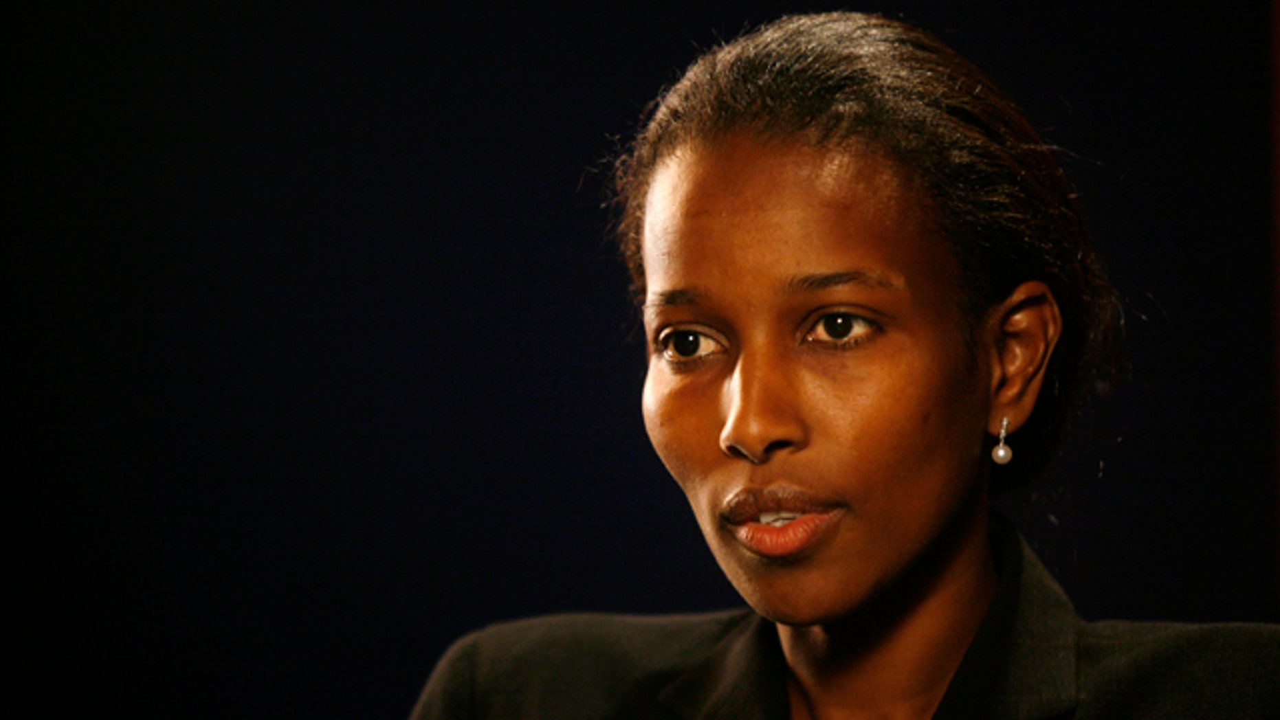 This 2007 photo shows Ayaan Hirsi Ali, writer of the film 'Submission,' which criticized the treatment of women in traditional Islam and led to the murder of Dutch film director Theo Van Gogh. Brandeis University announced Tuesday it was withdrawing a planned honorary degree from Ali. (AP Photo/Shiho Fukada)