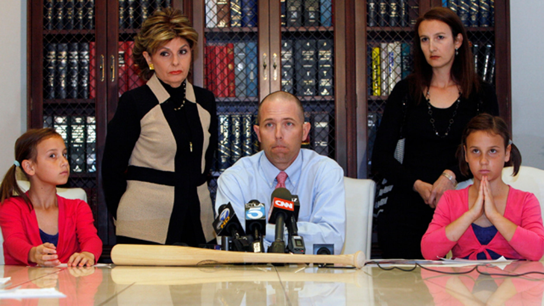 April 27: Justin Quinn, center, with his wife Jessica, right, and their twin daughters: Kylynn, far left, and Taylor, far right, take questions during a news conference organized by Los Angeles attorney Gloria Allred, standing left, in Los Angeles.