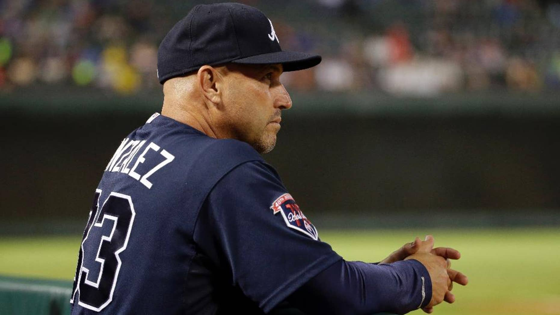 Atlanta Braves manager Fredi Gonzalez watches the Braves' baseball game against the Texas Rangers in the eighth inning Friday, Sept. 12, 2014, in Arlington, Texas. The Rangers won 2-1. (AP Photo/Tony Gutierrez)