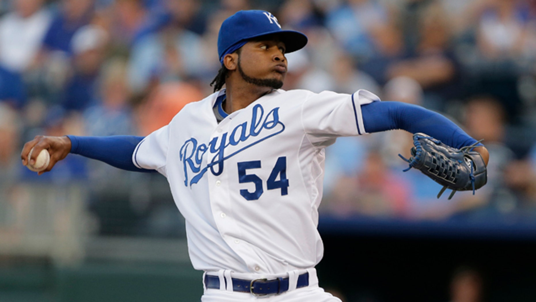 FILE - In this Aug. 20, 2013 file photo, Kansas City Royals starting pitcher Ervin Santana throws during the first inning of a baseball game against the Chicago White Sox, in Kansas City, Mo. The Atlanta Braves have signed Santana to bolster their injury plagued starting rotation. The team announced Wednesday, March 12, 2014, that Santana agreed to a one-year deal. (AP Photo/Charlie Riedel, File)