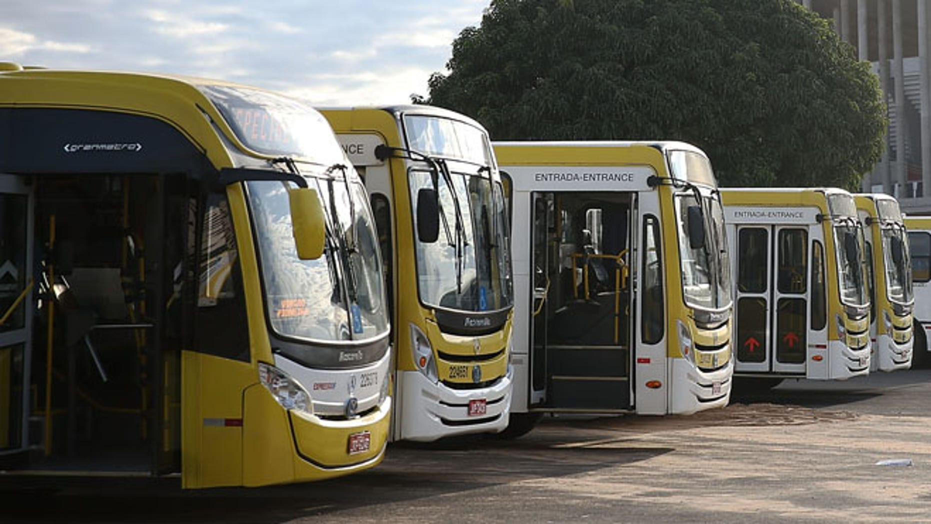 BRASILIA, BRAZIL - JUNE 03:  Buses are parked in front of the 72,000-seat Mane Garrincha Stadium, which is now used primarily as a municipal bus parking lot, on June 3, 2015 in Brasilia, Brazil. Brazil constructed a number of expensive stadiums for the 2014 FIFA World Cup which now sit mostly empty in part because there is no popular local team to draw attendance.  (Photo by Mario Tama/Getty Images)