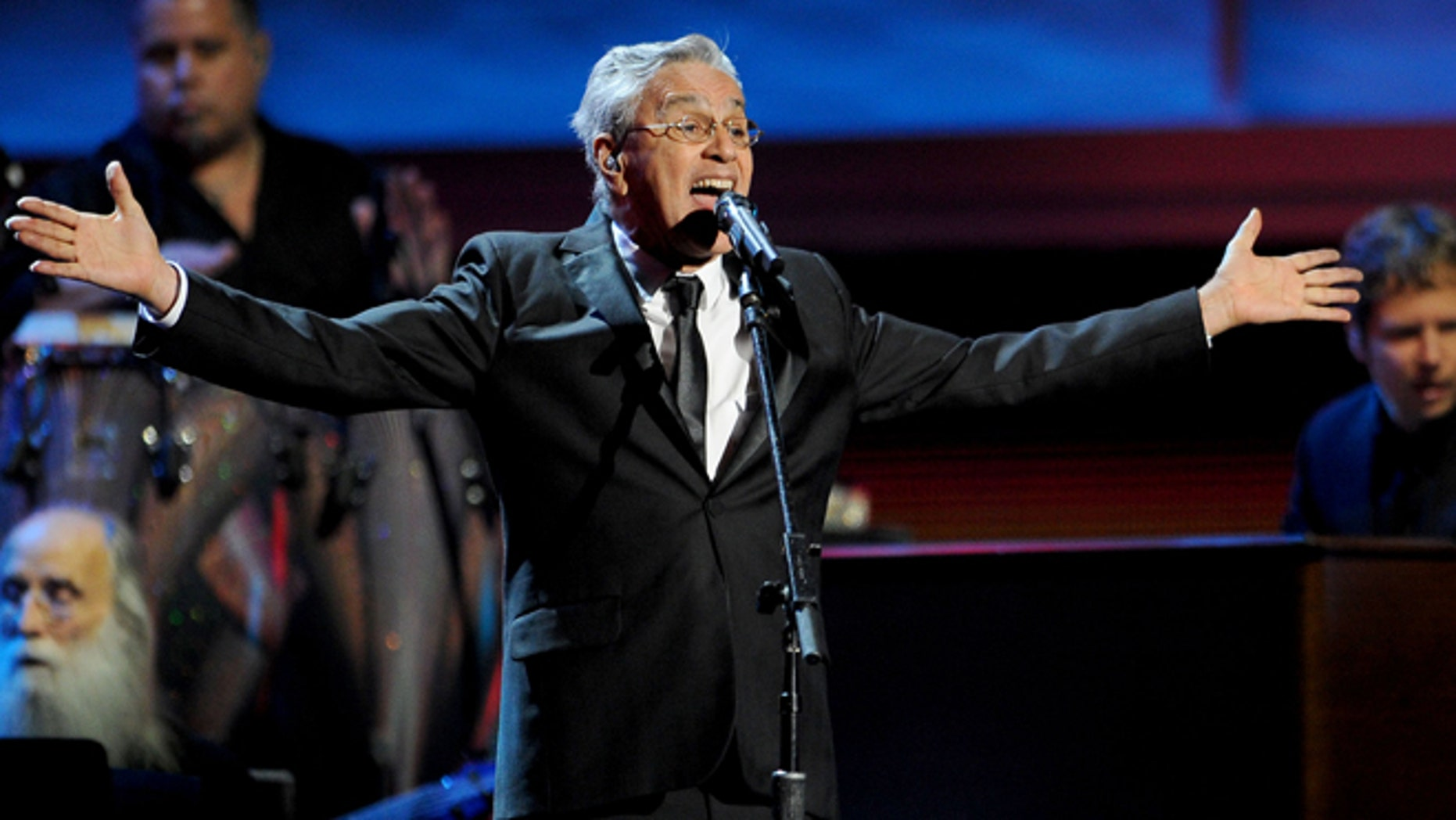 FILE - In this Nov. 15, 2012, file photo, Caetano Veloso performs at the 13th Annual Latin Grammy Awards at Mandalay Bay, in Las Vegas. Veloso is taking a shellacking from the press and his fan base alike, who say heâs endorsing censorship by leading the defense of a wide-ranging law that allows Brazilians to block or pull from the shelves any biographical work about them that was created without their consent. (AP Photo/Invision/Al Powers, File)