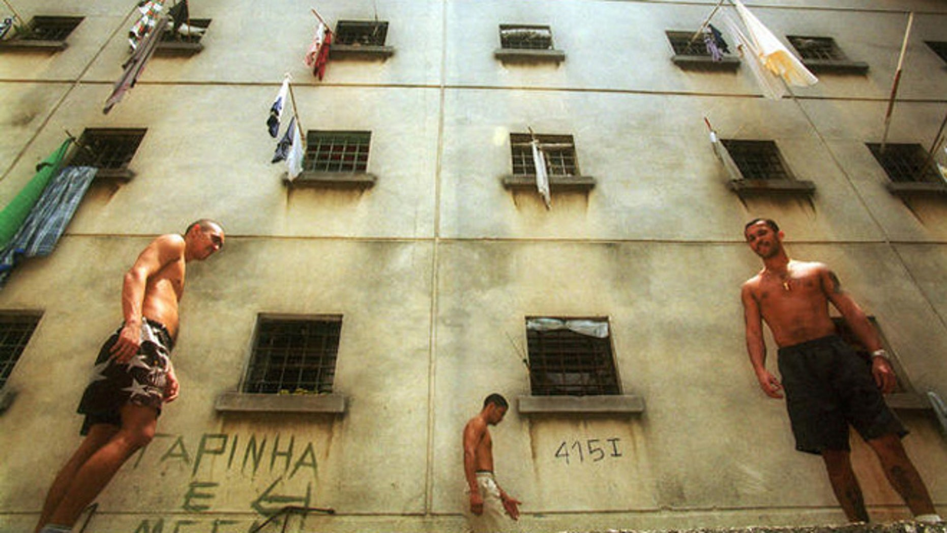 Inmates walk around a yard at the Carandiru detention center in Sao Paulo, Brazil, Oct. 11, 2000. Built for 3,200 inmates, the prison, which is perhaps best known for the massacre of 111 inmates by riot police during a 1992 rebellion, now houses 7,300 inmates and still smolders with violence and unrest. (AP Photo/Dario Lopez-Mills)