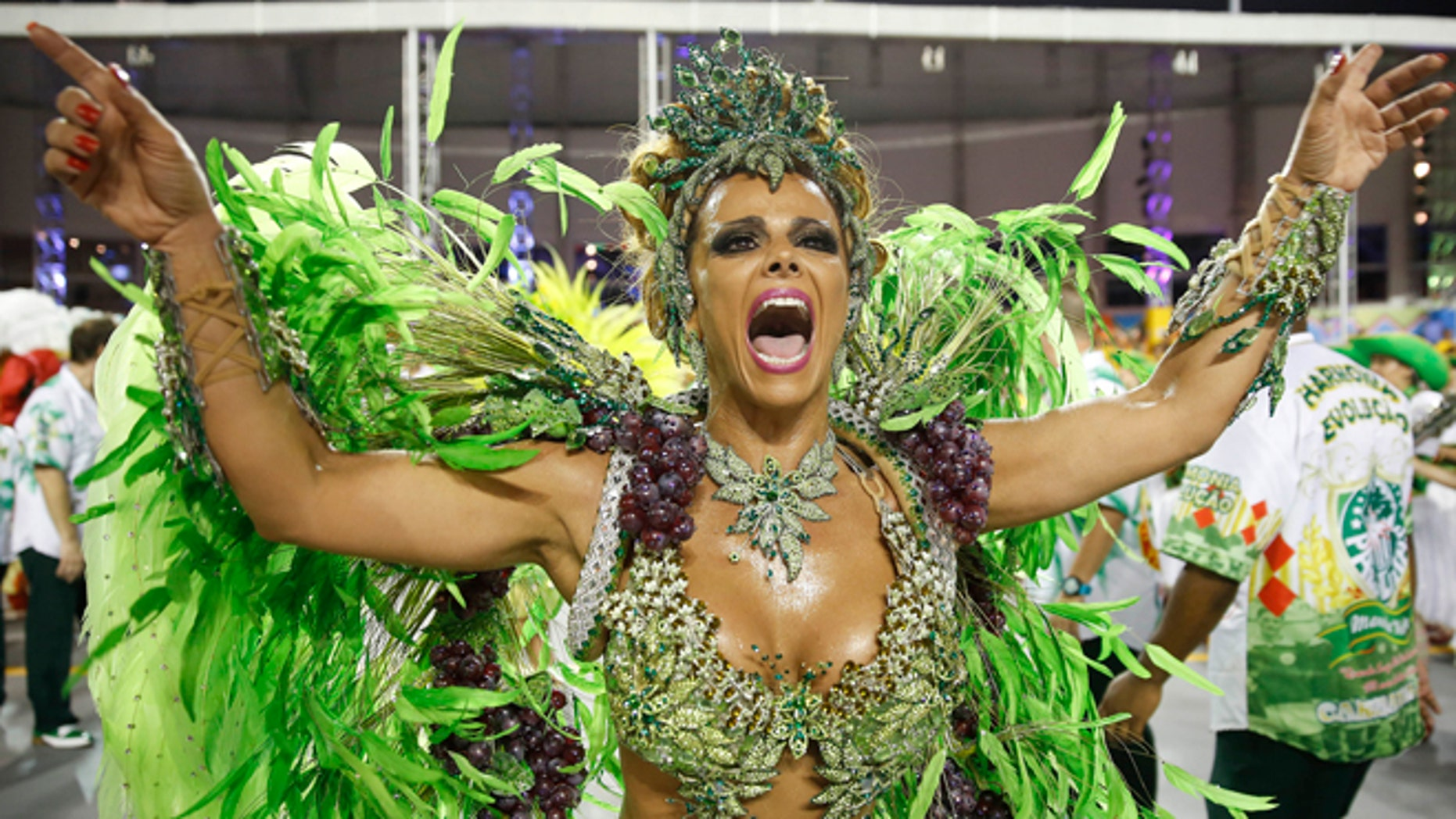 A dancer from the Mancha Verde samba school performs in the Carnival parade at the Sambodromo in Sao Paulo, Brazil, Friday, Feb. 13, 2015. (AP Photo/Andre Penner)