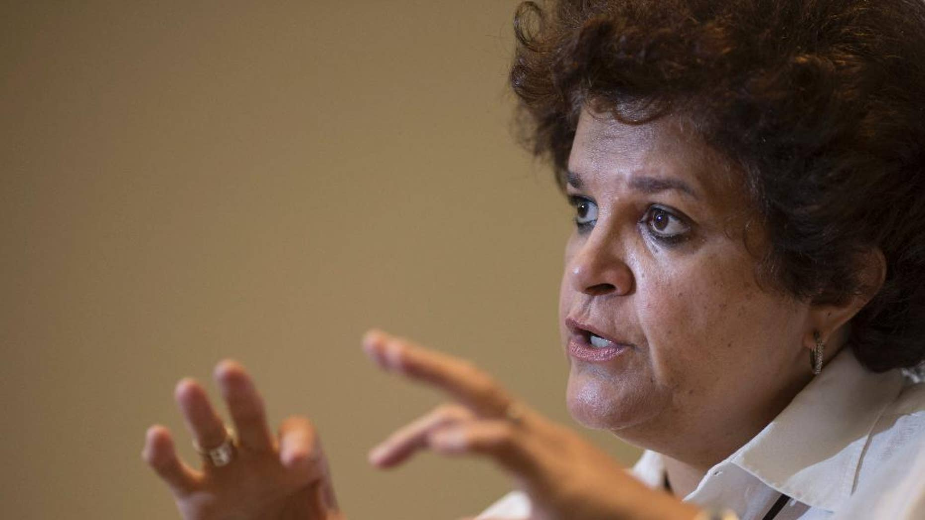 Brazil's Environment Minister Izabella Teixeira speaks during an interview in Rio de Janeiro, Brazil, Wednesday, Nov. 5, 2014. Teixeira says her nation will assume a protagonist role at a climate change conference in Peru, and will hold developed nations accountable for commitments to reduce carbon emissions. (AP Photo/Felipe Dana)
