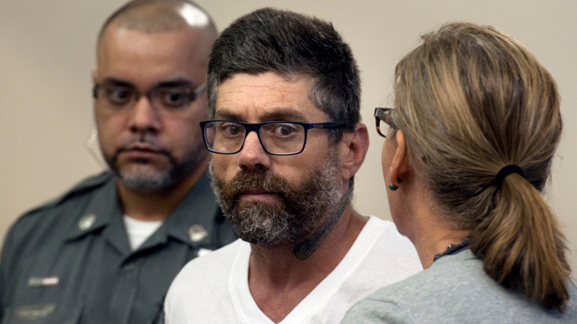 Walter DaSilva, center, of Danbury, Conn., appears in Superior Court for an extradition hearing in Bridgeport, Conn., on Monday, Aug. 8, 2016. DaSilva was arrested in Bridgeport on Friday, and is wanted as a suspect in the July 3 fatal shooting of his 19-year old daughter, Sabrina DaSilva, in New Bedford, Mass. (Ned Gerard/Hearst Connecticut Media via AP, Pool)