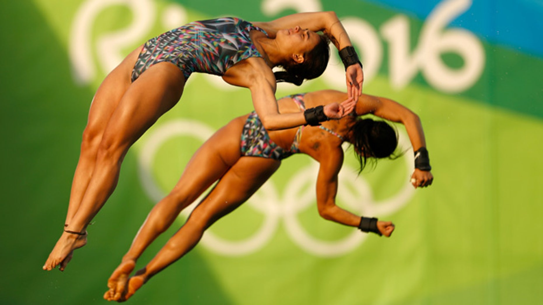 RIO DE JANEIRO, BRAZIL - AUGUST 09:  Ingrid Oliveira and Giovanna Pedroso of Brazil compete in the Women's Diving Synchronised 10m Platform Final on Day 4 of the Rio 2016 Olympic Games at Maria Lenk Aquatics Centre on August 9, 2016 in Rio de Janeiro, Brazil.  (Photo by Clive Rose/Getty Images)
