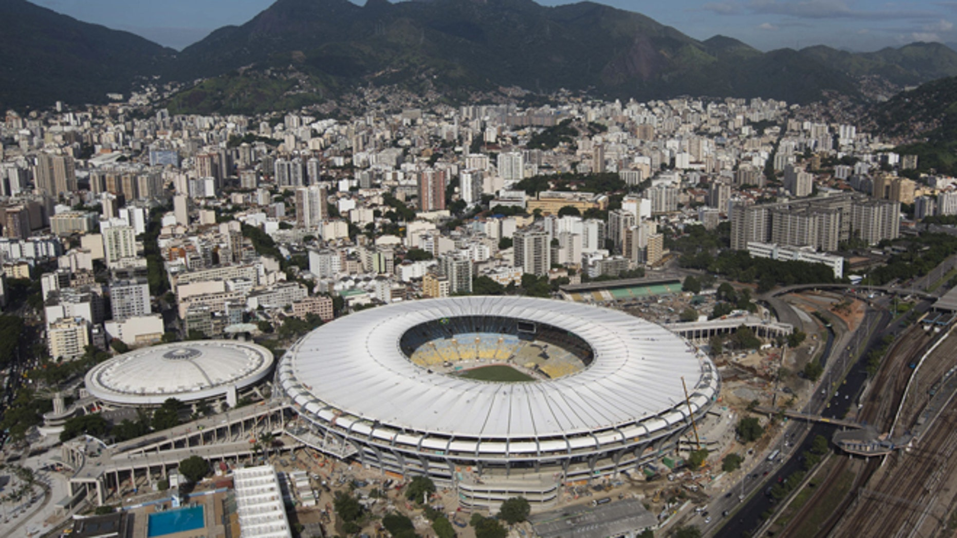 FILE - This April 11, 2013 file photo shows the new Maracana Stadium in Rio de Janeiro, Brazil. The Maracana's capacity has been reduced to just under 79,000 _ it held more than 170,000 for the final match of the 1950 World Cup _ and plans call for it to be eventually shared by Brazilian clubs Flamengo and Fluminense. (AP Photo/Felipe Dana, File)