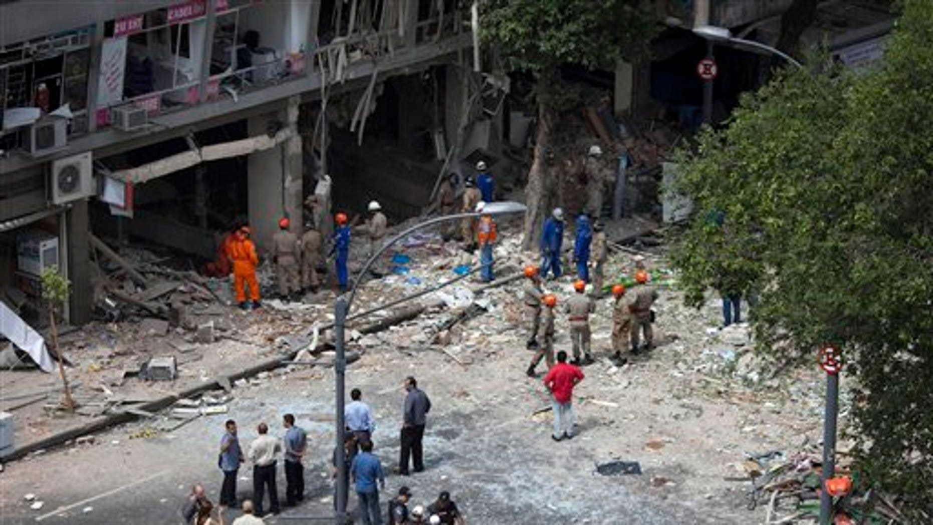 October 13: Emergency workers stand in debris after an explosion that caused heavy damage to a restaurant in Rio de Janeiro, Brazil.