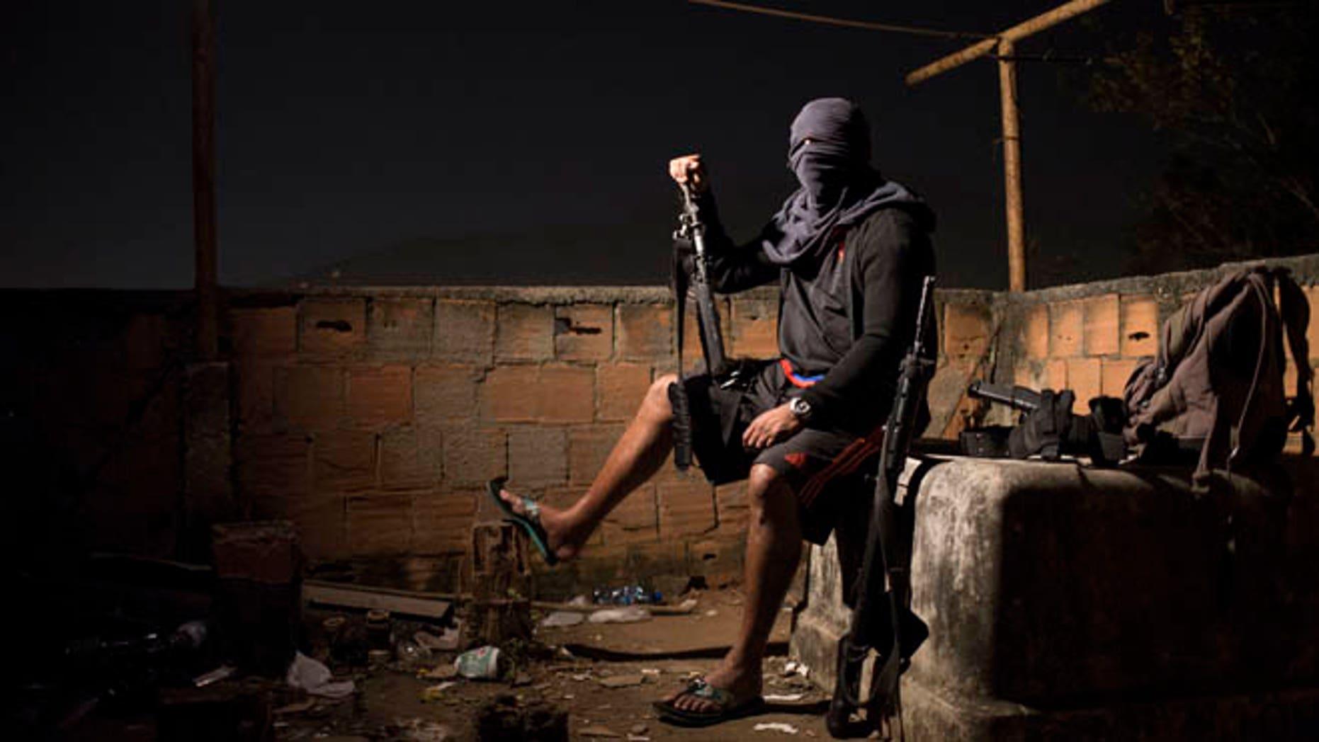 A drug gang leader poses for a photo in a slum in Rio de Janeiro, Brazil.