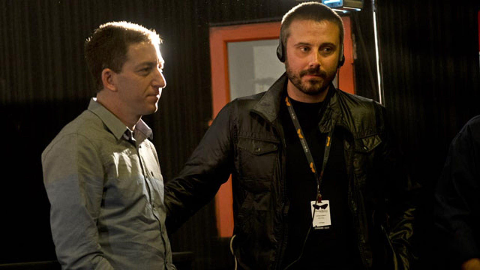 """September 28, 2013: American journalist Jeremy Scahill, right, and Glenn Greenwald wait for the beginning of a panel following the screening of the """"Dirty Wars"""" documentary, based on a book of the same name by Scahill, at the Rio Film Festival in Rio de Janeiro, Brazil. (AP Photo)"""