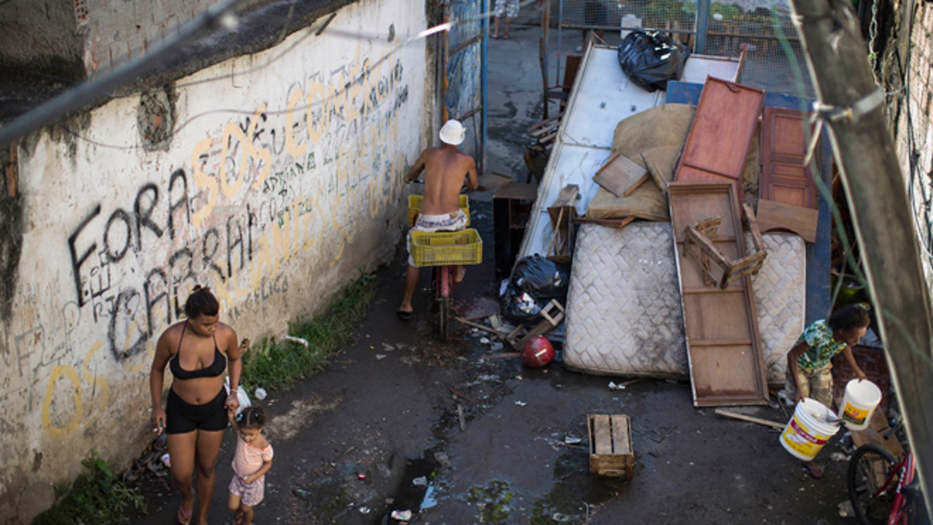 Residents walk inside the Favela do Metro slum near Maracana stadium, on Jan. 9, 2014.