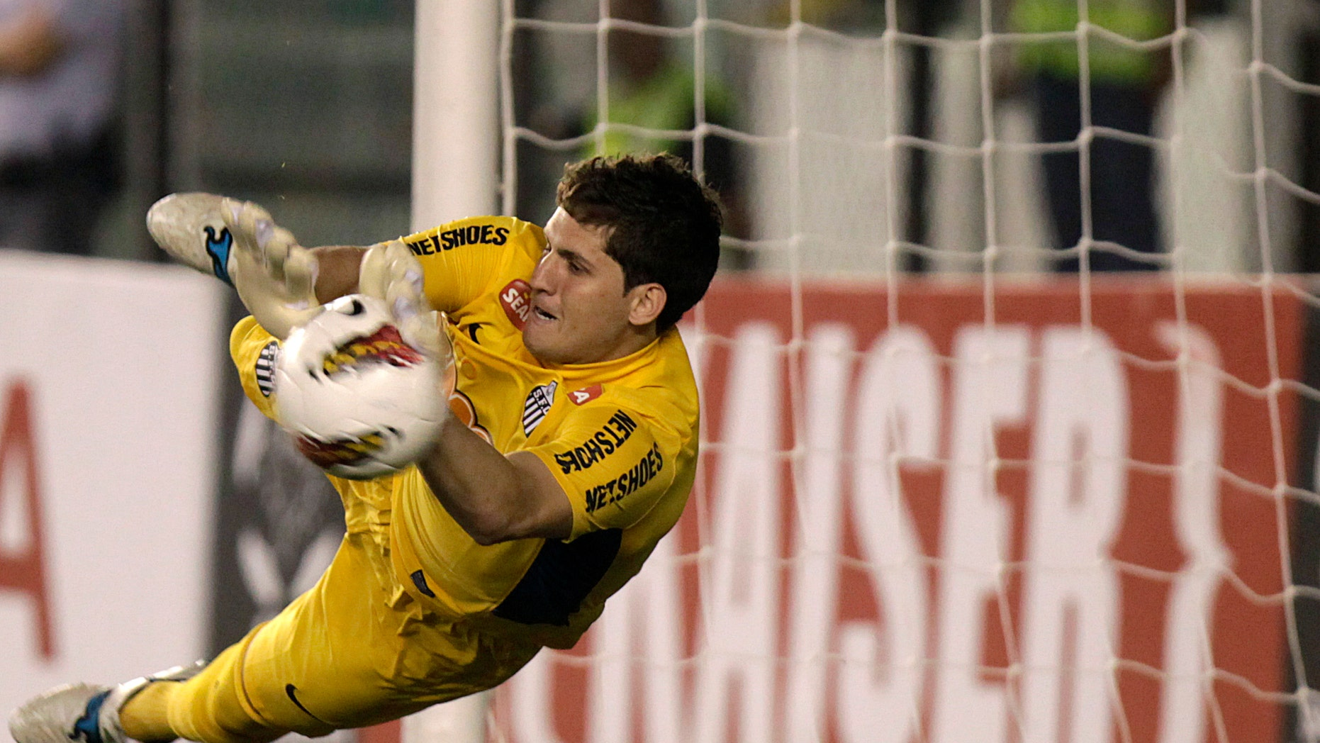 May 24, 2012: In this file photo Brazil's Santos' goalkeeper Rafael stops a shot in the penalty shootout of a Copa Libertadores soccer match in Santos, Brazil.