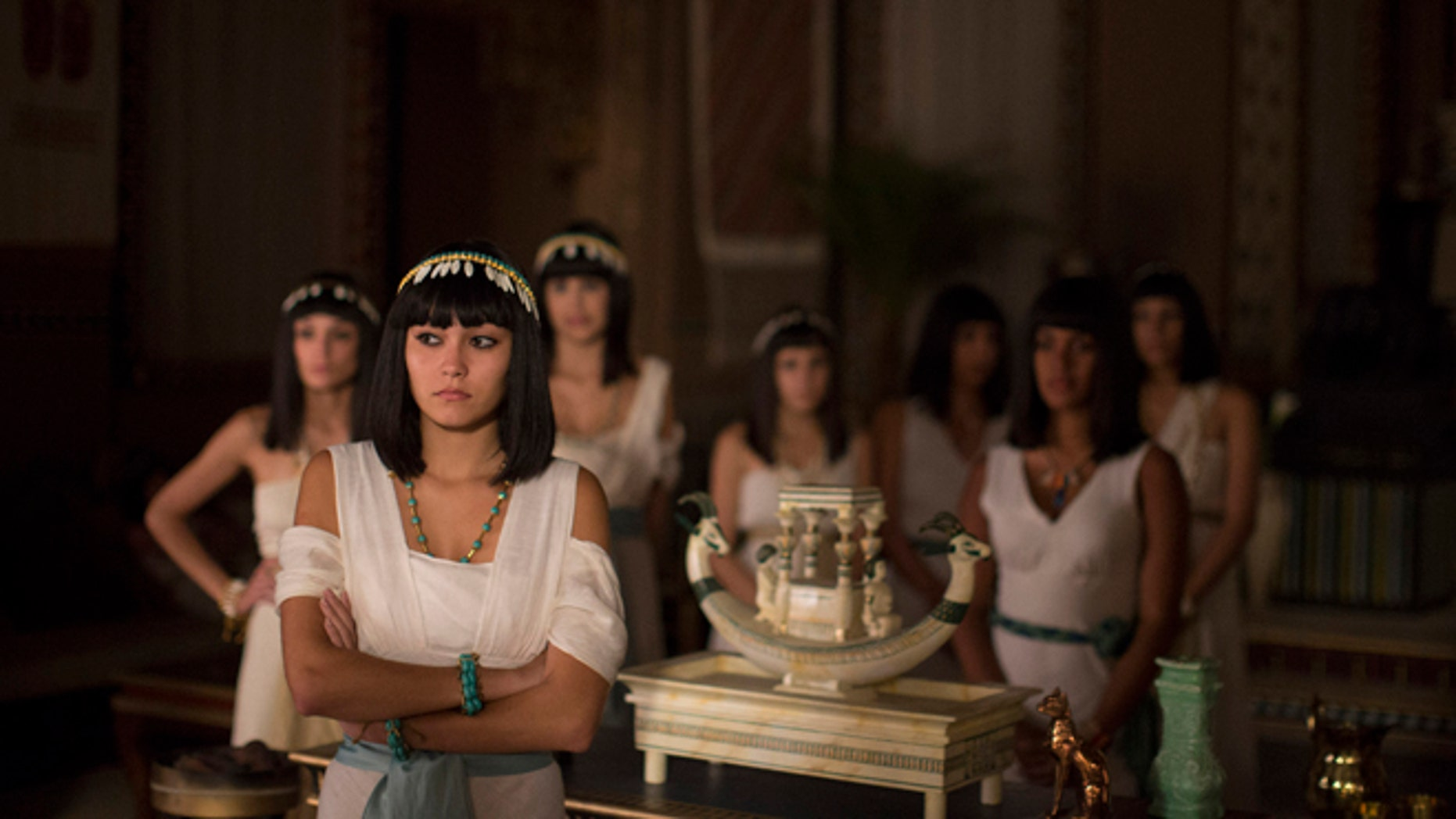 """In this May 13, 2015 photo, Brazilian actresses wait backstage for their cue during the filming of the Brazilian prime-time soap opera, """"The Ten Commandments"""" at a RecNov studio, in Rio de Janeiro, Brazil. Swathed in Egyptian cotton robes and sporting lapis lazuli jewelry and Cleopatra wigs, some of the characters are based on Biblical or other historic figures, while others are invented. (AP Photo/Leo Correa)"""