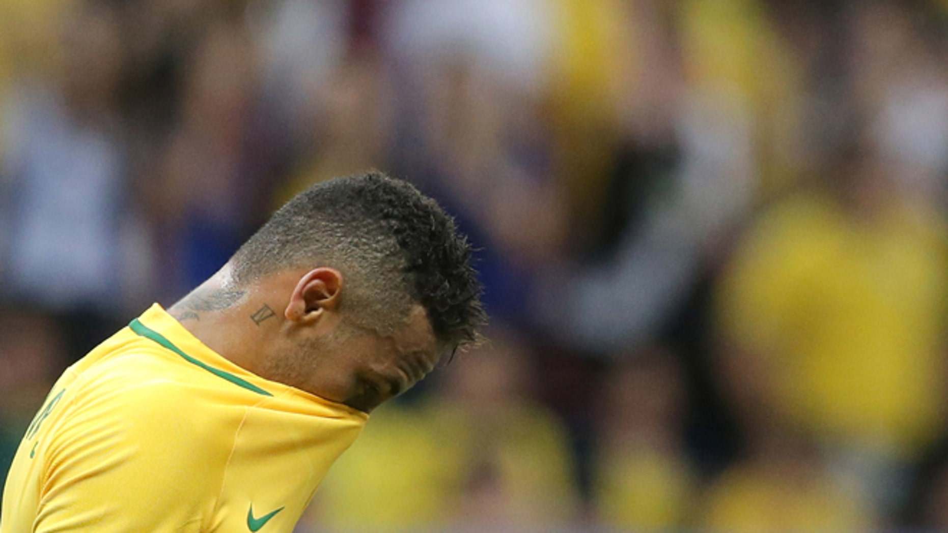 Brazil's Neymar reacts at the end of a group A match of the men's Olympic football tournament between Brazil and Iraq at the National Stadium in Brasilia, Brazil, Sunday, Aug. 7, 2016. The game ended in a 0-0 draw. (AP Photo/Eraldo Peres)