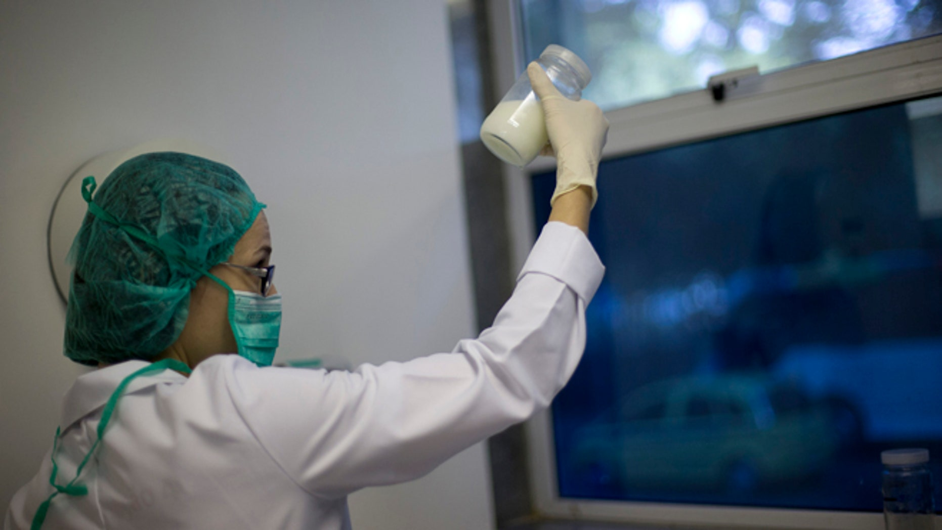 A lab technician examines the quality of donated human milk at the Fernandes Figueira Institute in Rio de Janeiro.
