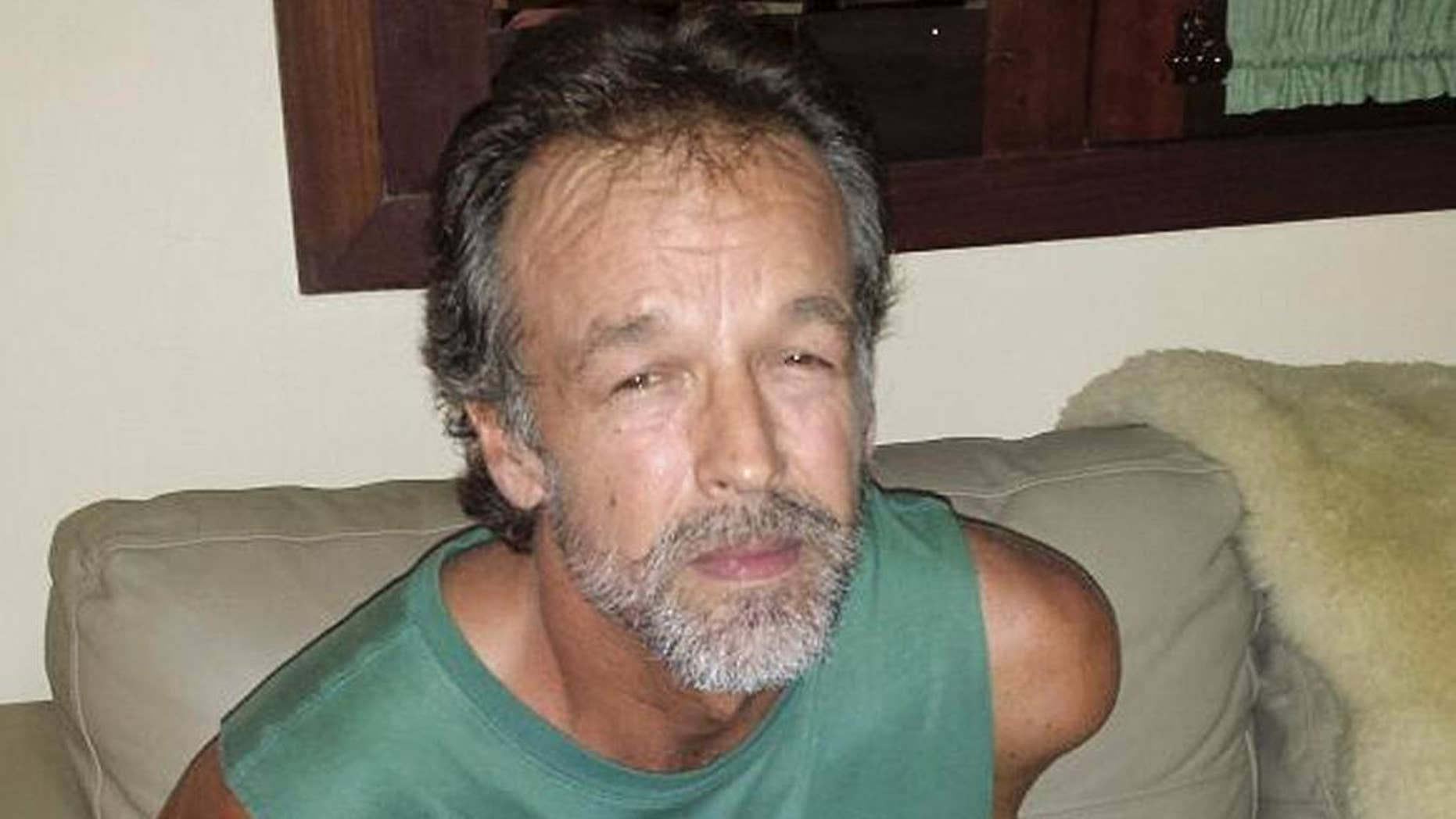 In this photo released by Rio Grande do Norte State Security secretary, American sect leader Victor Arden Barnard sits in a police station after being detained at Pipa beach, in the Northeastern state of Rio Grande do Norte, Brazil, Friday, Feb. 27, 2015. Barnard is facing 59 counts of criminal sexual conduct related to two young women who said they were abused for nearly a decade at his secluded River Road Fellowship in Minnesota. (AP Photo/Rio Grande do Norte State Security Secretary)