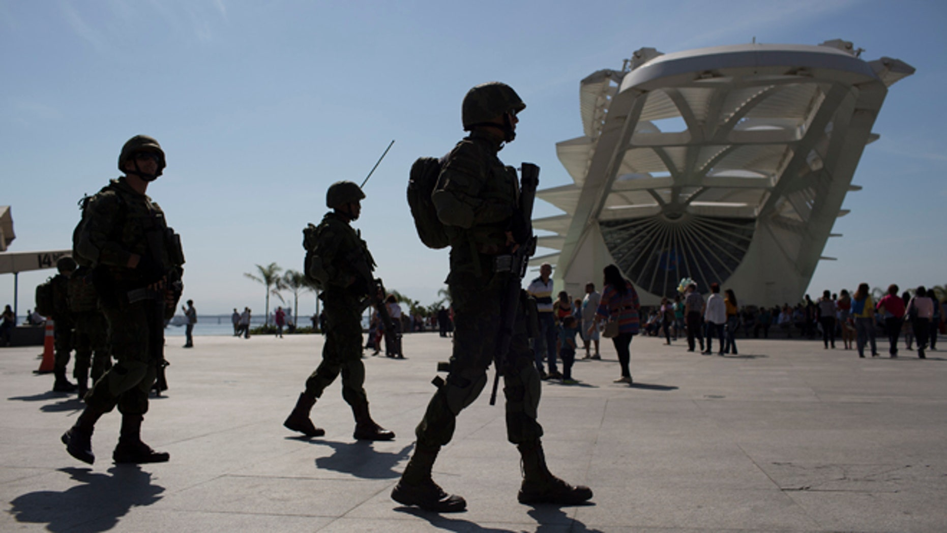 Soldiers patrol outside the Museum of Tomorrow in Rio de Janeiro, Brazil, Saturday, July 9, 2016. Roughly twice the security contingent at the London Olympics will be deployed during the August games in Rio, which are expected to draw thousands of foreigners to a city where armed muggings, stray bullets and turf wars between heavily armed drug gangs are routine. (AP Photo/Leo Correa)