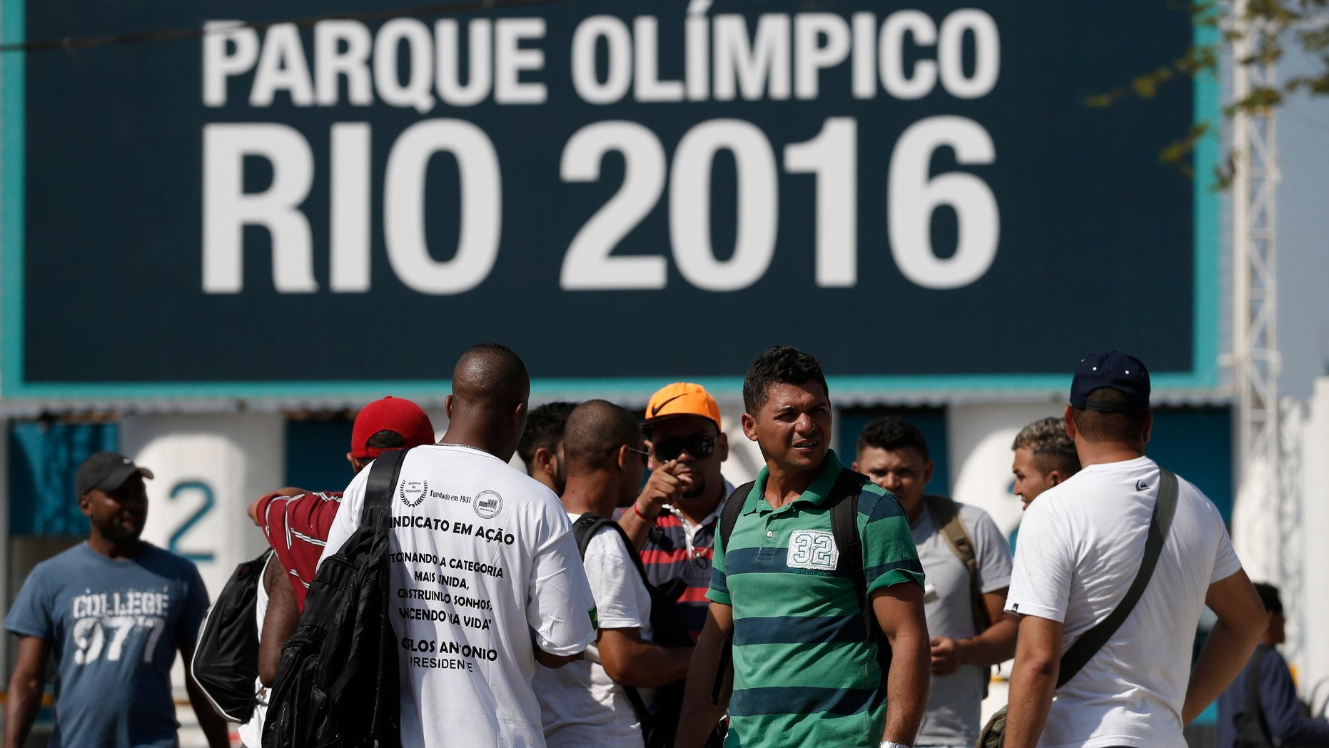 April 8, 2014: Striking workers stand in front the entrance of the Olympic Park, the main cluster of venues under construction for the 2016 Summer Olympic Games, in Rio de Janeiro, Brazil.