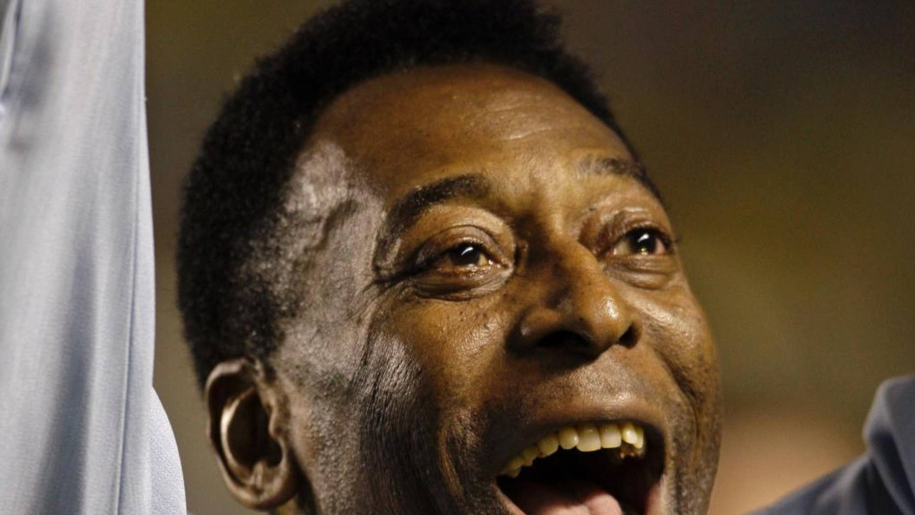 "FILE - In this Nov. 19,  2008 file photo, Brazil's soccer great Pele greets supporters prior to a friendly soccer match, in Brasilia, Brazil. A Brazilian hospital says Pele has been transferred to a ""special care"" unit to be monitored while being treated for a urinary infection. The Albert Einstein hospital in Sao Paulo, said in a statement Thursday. Nov. 27, 2014,  that the 74-year-old Pele was transferred to a quieter wing. (AP Photo/Silvia Izquierdo, File)"
