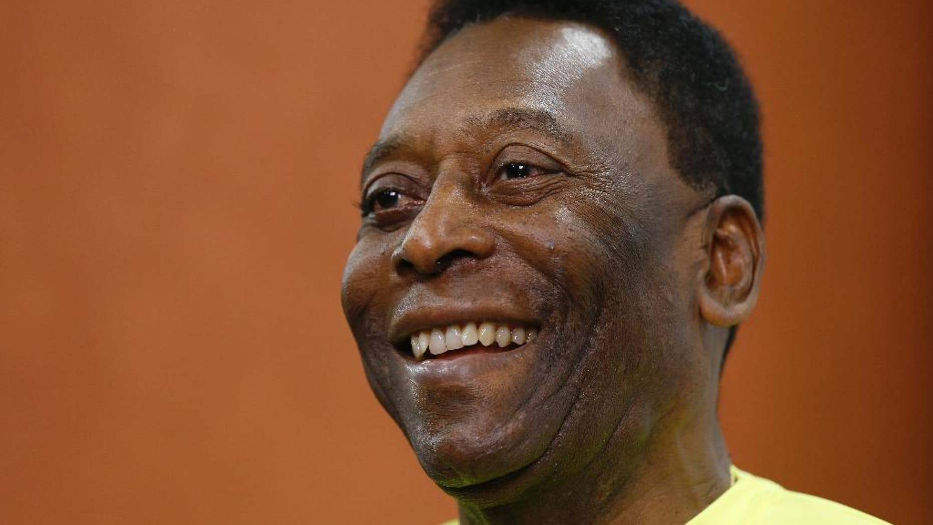 FILE - In this March 20, 2015, file photo, Brazilian soccer legend Pele smiles during a media opportunity at a restaurant in London. A Brazilian hospital says Pele is hospitalized in Sao Paulo. Mirtes Bogea, a press officer for the Albert Einstein hospital, said Saturday, July 18, 2015 she could only confirm Pele's hospitalization. She said she was not allowed to say when he was hospitalized or why. (AP Photo/Kirsty Wigglesworth,File)
