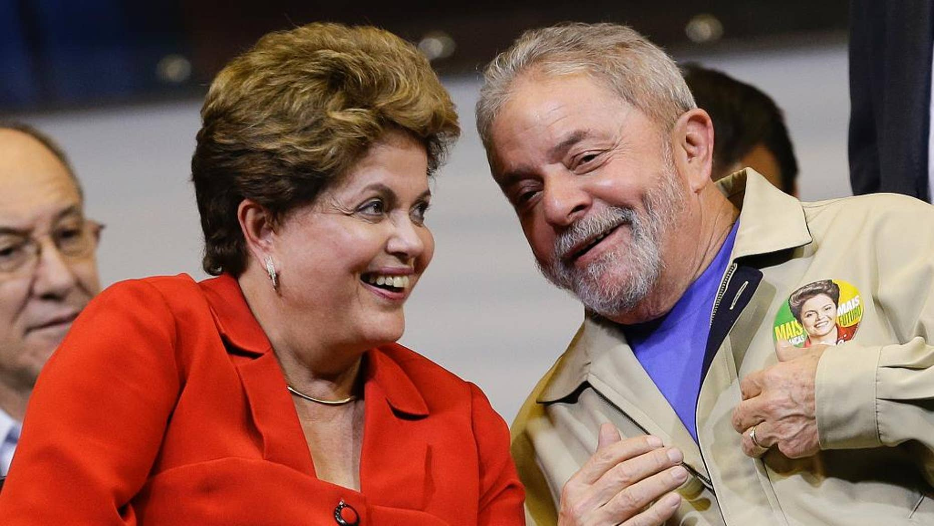 FILE - In this Aug. 7, 2014,file photo, Brazil's President Dilma Rousseff and former Brazilian President Luiz Ignacio Lula da Silva attend an election campaign rally in Sao Paulo, Brazil. A convicted black market money dealer who turned state's evidence told lawmakers on Tuesday, Aug. 25, 2015, that President Rousseff and her predecessor, former President Lula da Silva, knew of the sprawling corruption kickback scheme that has engulfed state-run oil company Petrobras. (AP Photo/Andre Penner,File)