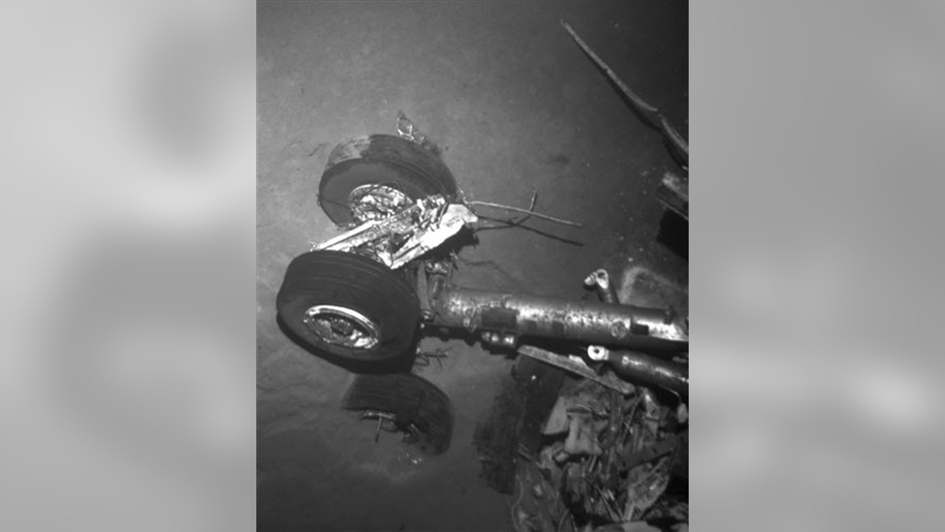 This undated black and white photo provided Monday April 4, 2011 by France's air accident investigation agency, the BEA, shows a landing gear of flight AF447, which crashed off Brazil.