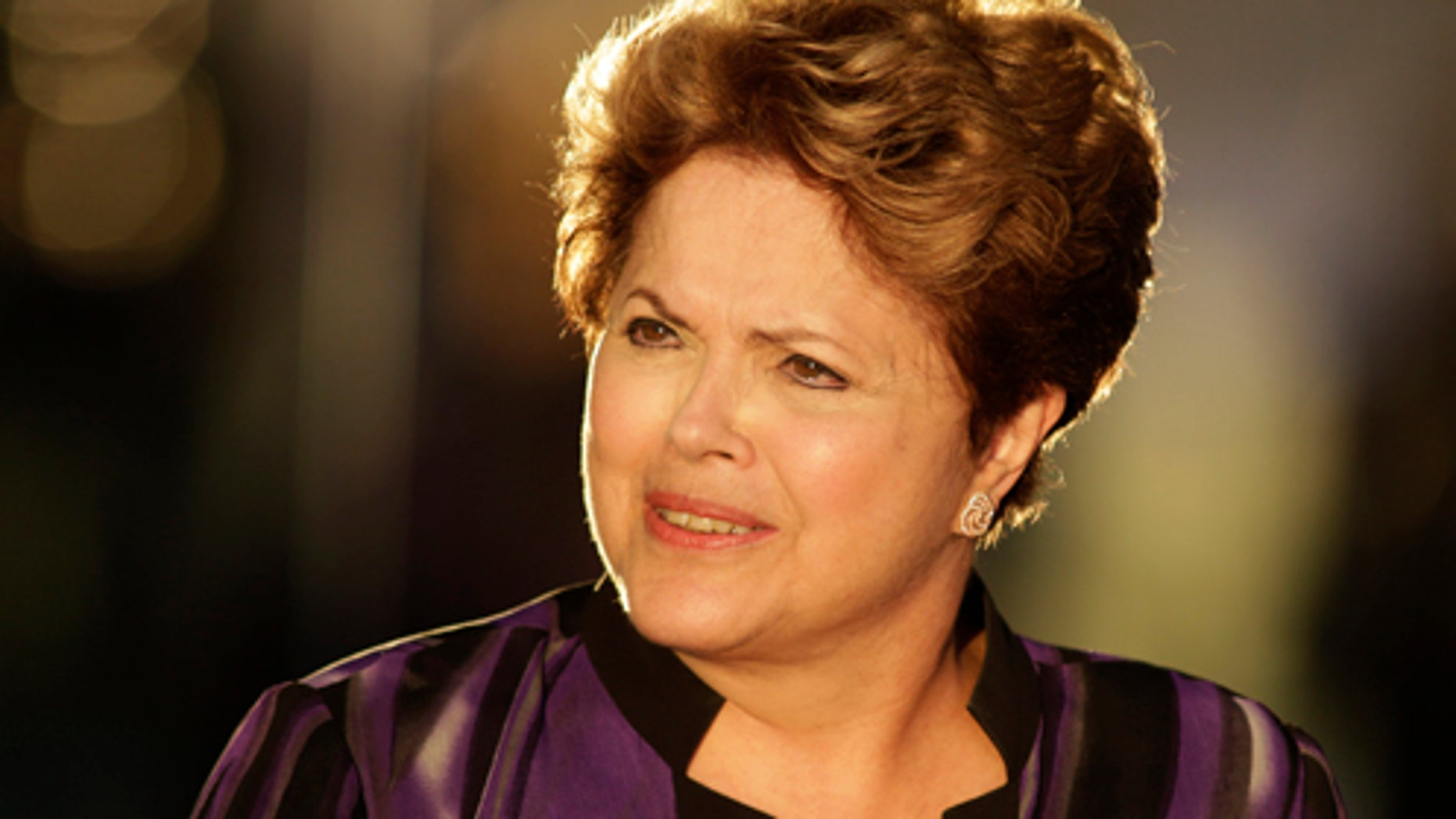 """Brazil's President Dilma Rousseff arrives to meet members of Brazil's soccer team at Alvorada palace in Brasilia, Brazil, Monday, Sept. 2, 2013. The Brazilian government condemned a U.S. spy program that reportedly targeted the nation's leader, labeled it an """"unacceptable invasion"""" of sovereignty and called Monday for international regulations to protect citizens and governments alike from cyber espionage. (AP Photo/Eraldo Peres)"""