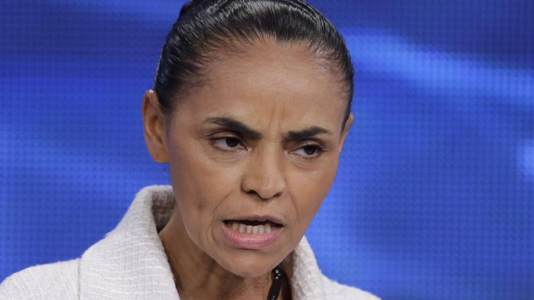 Marina Silva, presidential candidate of the Brazilian Socialist Party, PSB speaks during a televised presidential debate in Sao Paulo, Brazil, Tuesday, Aug. 26, 2014. A new poll shows Silva as the leading rival to Brazil's President Dilma Rousseff and would defeat her in a second-round runoff vote in October's election. (AP Photo/Nelson Antoine)