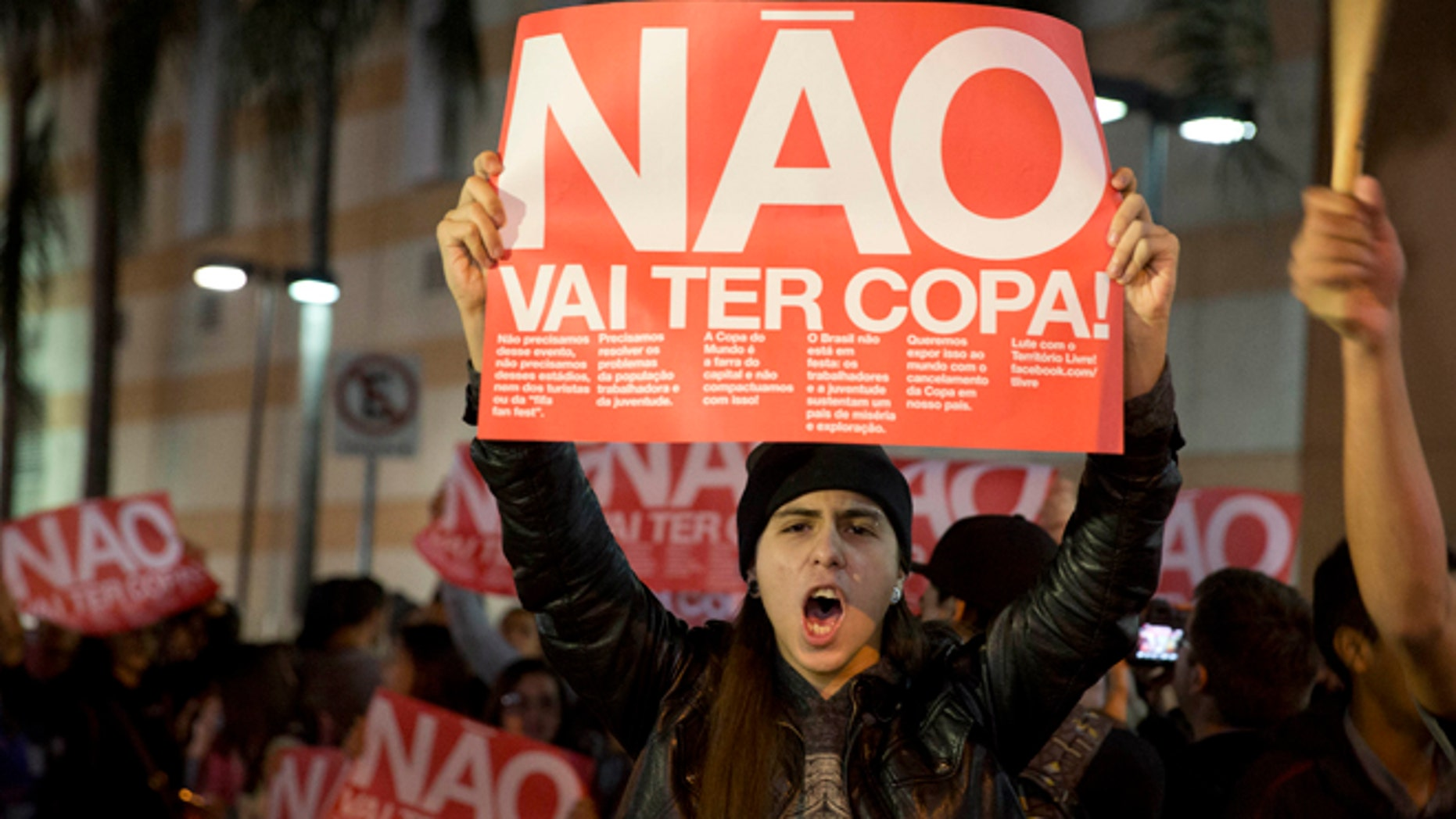 """A demonstrator holds a banner that reads """"There Won't be a Cup"""" in Sao Paulo, Tuesday, April 29, 21014."""