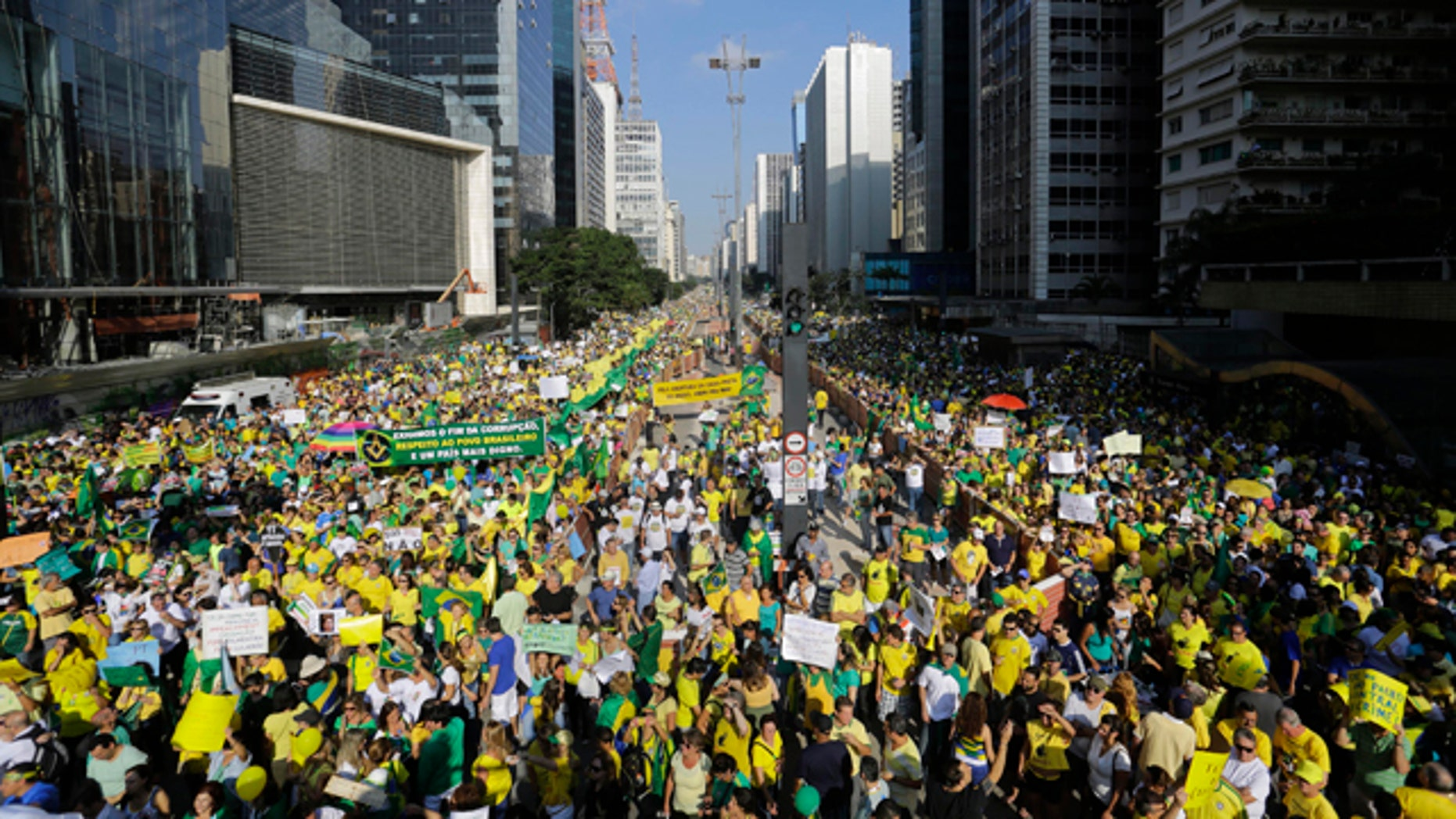 April 12, 2015: Demonstrators take part in an anti-government protest in Sao Paulo, Brazil. Anti-government demonstrators streamed into the streets throughout Brazil to demand the impeachment of President Dilma Rousseff. (AP Photo/Nelson Antoine)
