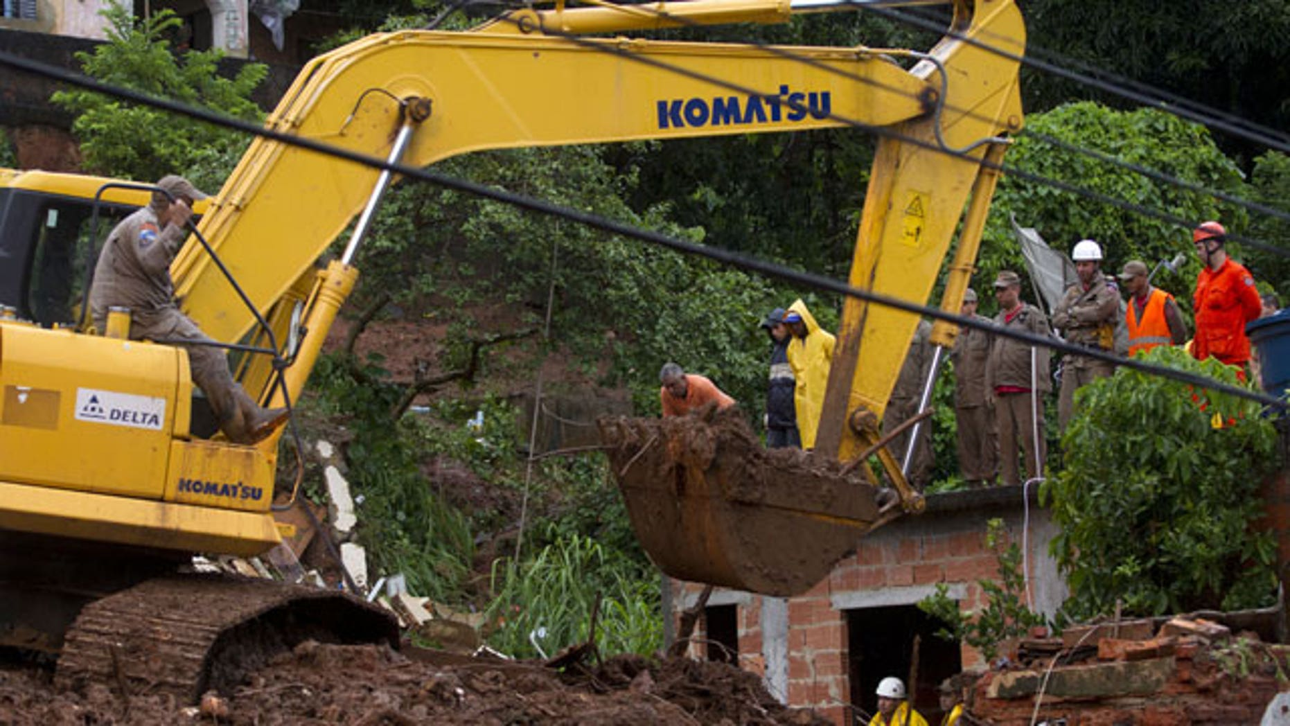 January 9, 2012: Rescue personnel work at the site of a mudslide that killed at least eight people in Jamapara, Rio de Janeiro state, Brazil.