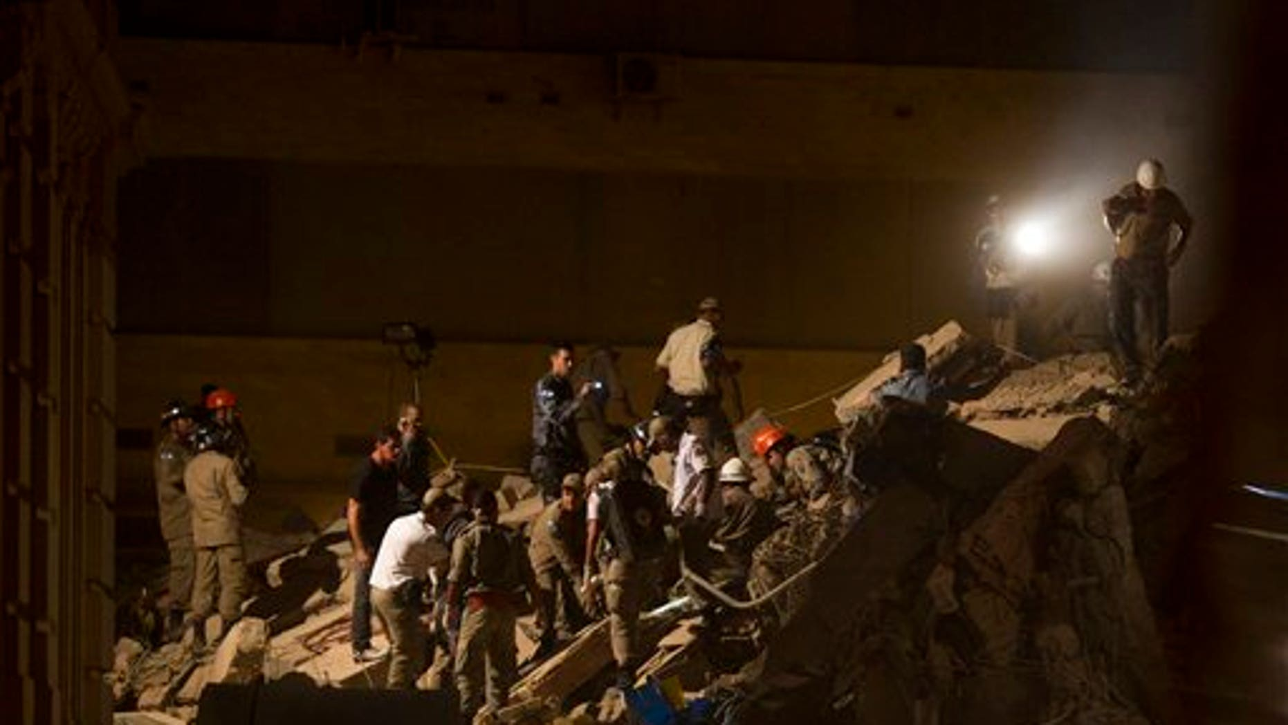Jan. 25: Rescue workers search for victims after a building collapsed in Rio de Janeiro, Brazil.