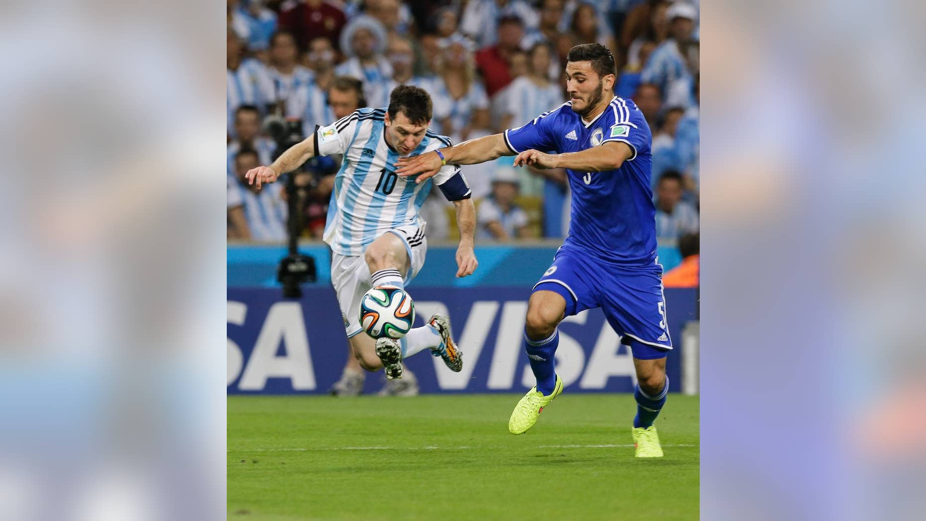 Bosnia's Sead Kolasinac, right, tries to stop Argentina's Lionel Messi (10) during their group F World Cup soccer match at the Maracana Stadium in Rio de Janeiro, Brazil, Sunday, June 15, 2014. (AP Photo/Thanassis Stavrakis)