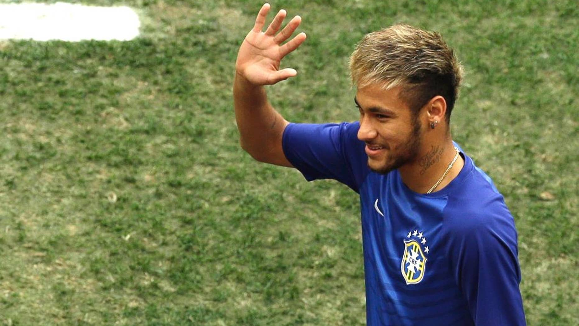 Brazil's Neymar waves as he enters the pitch to sit on the bench before the World Cup third-place soccer match between Brazil and the Netherlands at the Estadio Nacional in Brasilia, Brazil, Saturday, July 12, 2014. (AP Photo/Themba Hadebe)