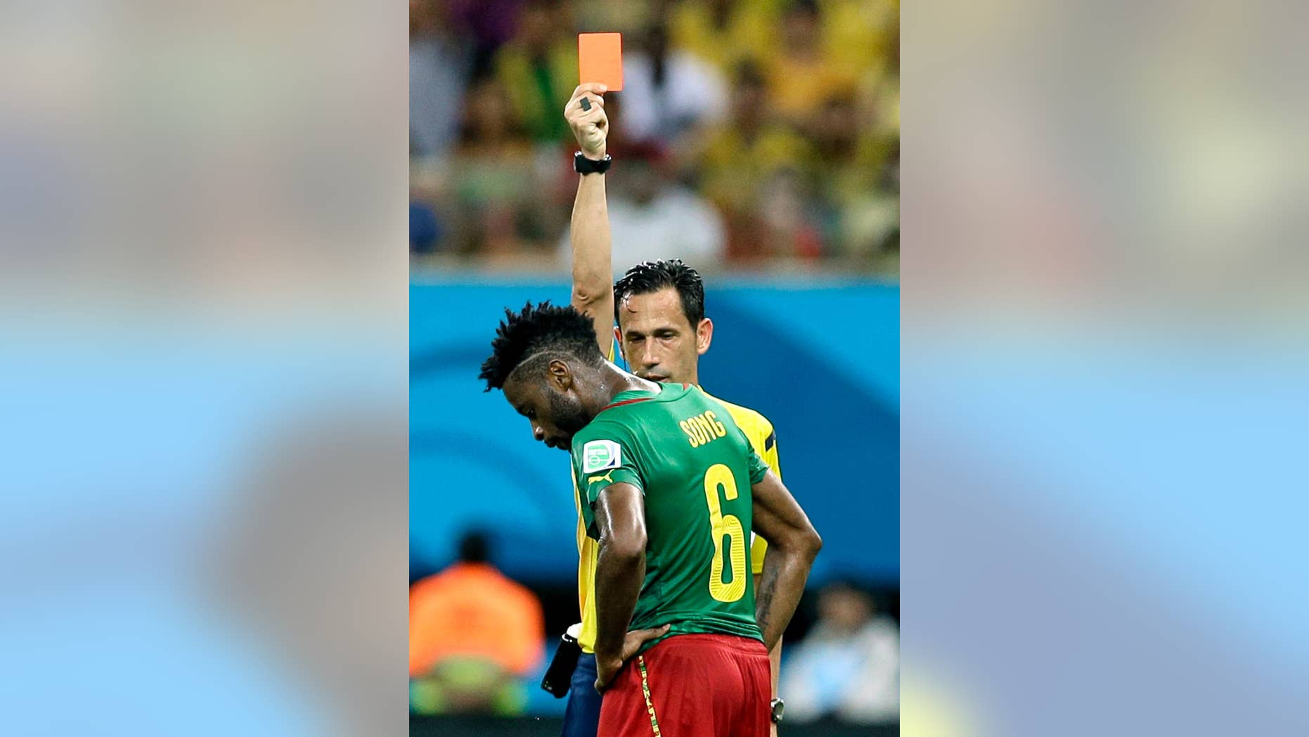 """FILE - In this Wednesday, June 18, 2014 file photo, referee Pedro Proenca from Portugal gives a red card to Cameroon's Alex Song during the group A World Cup soccer match between Cameroon and Croatia at the Arena da Amazonia in Manaus, Brazil. Cameroon's football federation said late Monday, June 30, 2014, it will investigate allegations of match-fixing by its team at the World Cup and the possible existence of """"seven bad apples"""" in the squad. (AP Photo/Themba Hadebe, File)"""