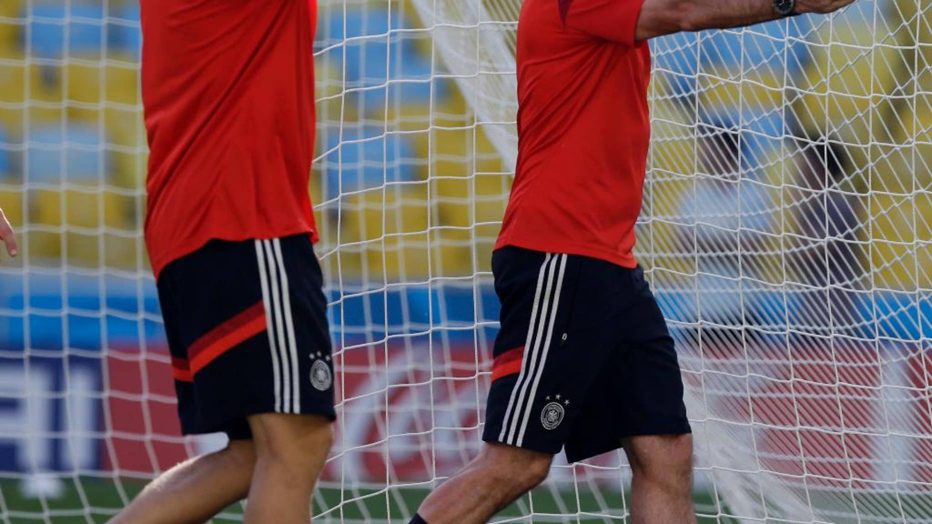 Germany's head coach Joachim Loew, right, with an assistant, check the pitch during an official training session a day prior to the quarter final World Cup soccer match between France and Germany at the Maracana stadium in Rio de Janeiro, Brazil, Thursday, July 3, 2014. (AP Photo/Thanassis Stavrakis)