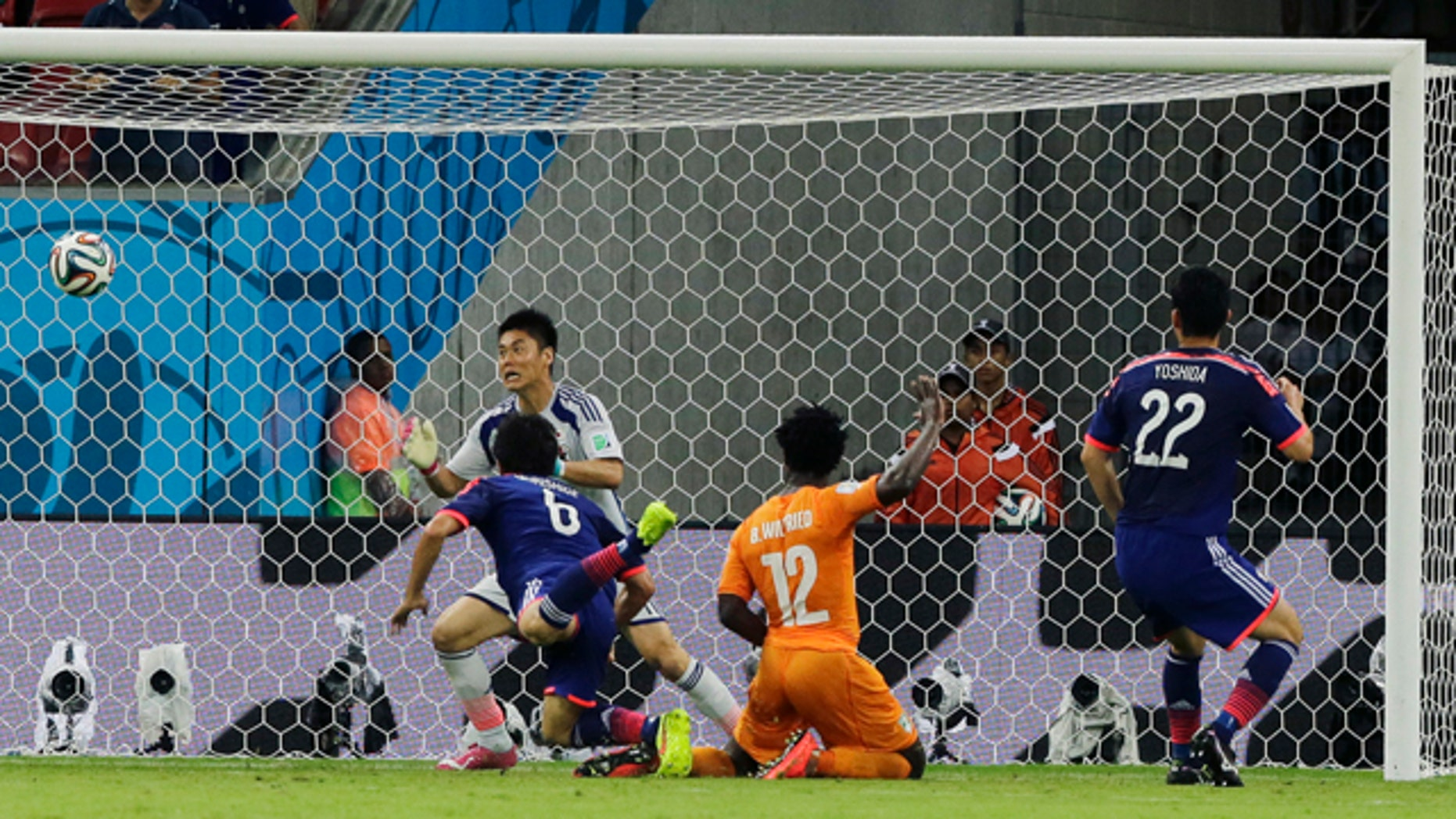 June 14, 2014: Ivory Coast's Wilfried Bony, (12), scores his side's first goal during the group C World Cup soccer match between Ivory Coast and Japan at the Arena Pernambuco in Recife, Brazil. (AP Photo/Shuji Kajiyama)