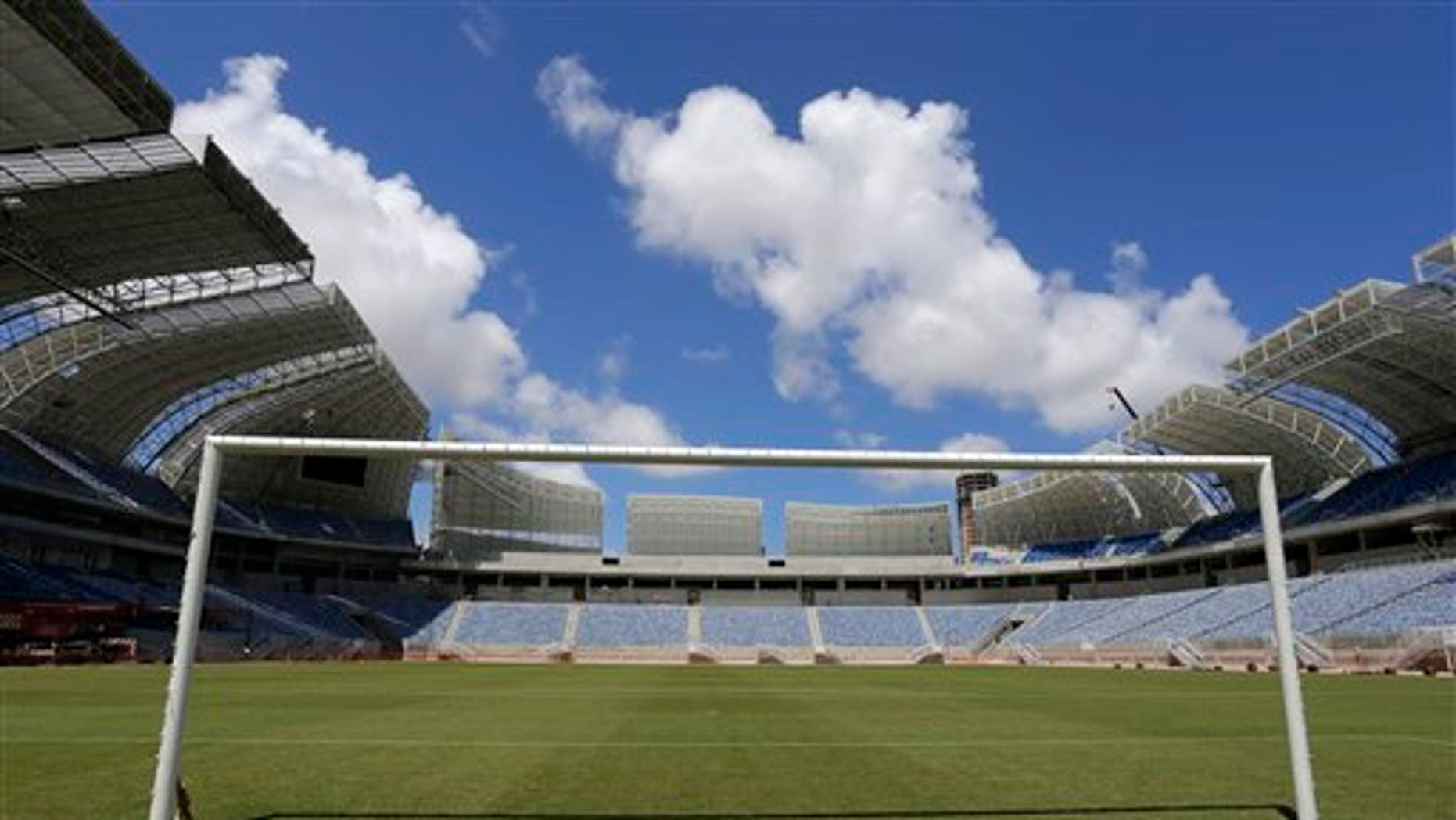 The empty goal stands in the Estadio das Dunas in Natal, Brazil, Friday, Dec. 13, 2013. Four matches of the 2014 soccer World Cup will be played in the stadium. (AP Photo/Ferdinand Ostrop)