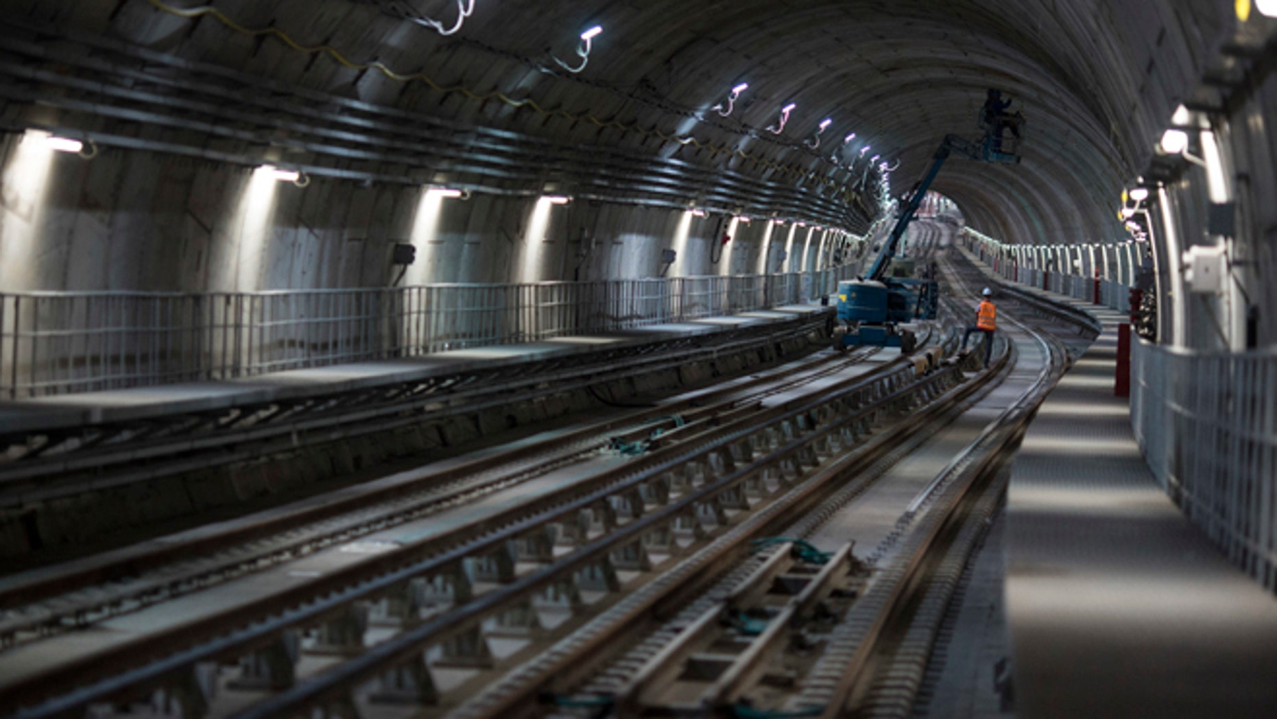 Men work in the new underground subway tunnel below Ipanema neighborhood in Rio de Janeiro, Brazil.