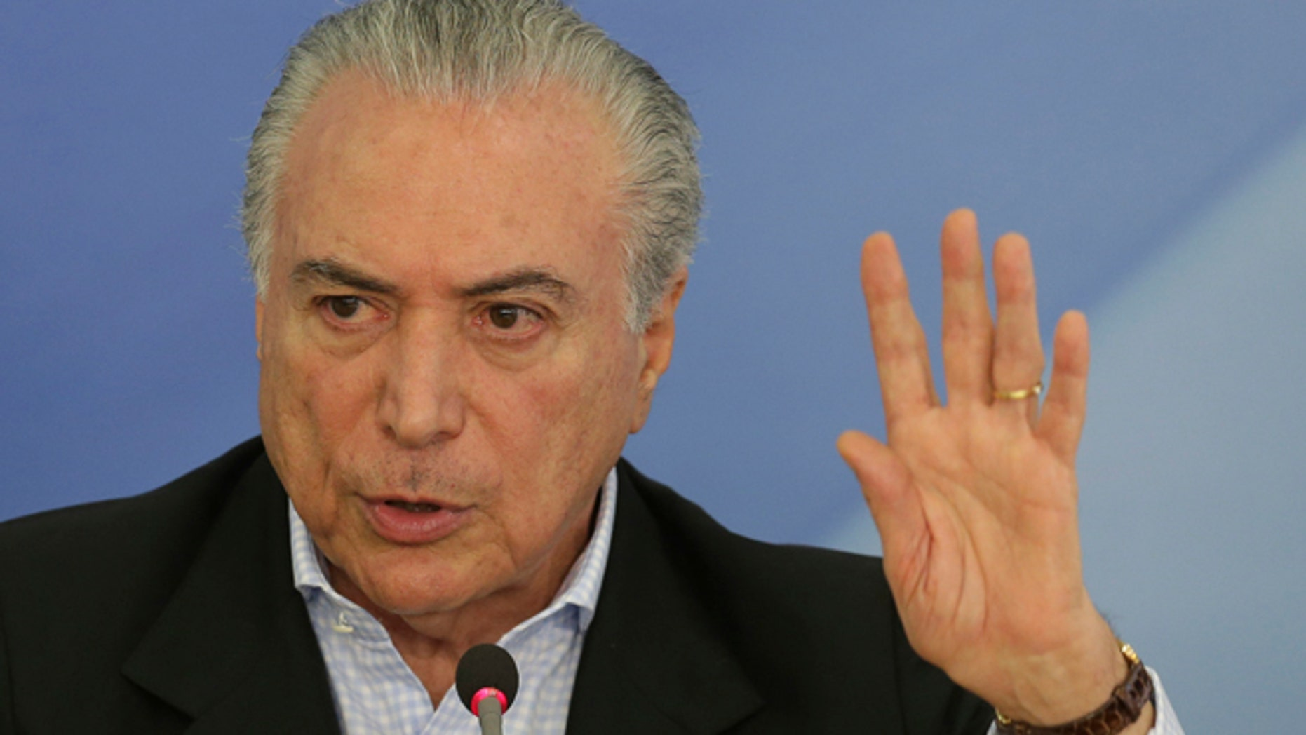 Brazil's President Michel Temer speaks to the press about proposed anti-corruption legislation in Brasilia, Brazil, Sunday, Nov. 27, 2016. Many Brazilians are concerned the legislation to toughen prosecution of corruption might perversely offer amnesty to politicians who had previously engaged in the practice. (AP Photo/Eraldo Peres)