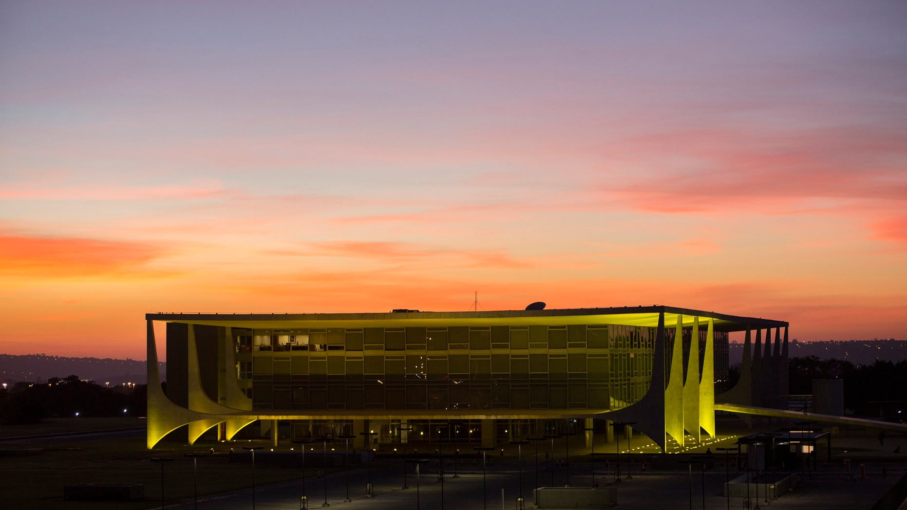 FILE - In this May 12, 2016, file photo, Planalto presidential palace during sunrise in Brasilia, Brazil, after the Senate voted to suspend President Dilma Rousseff pending an impeachment trial. For the sake of the nationâs 200 million people, and for all the South American nations whose fortunes are tied to Brazilâs powerhouse economy, one hopes that her vice president, now acting President, Michel Temer know what to do. (AP Photo/Felipe Dana)