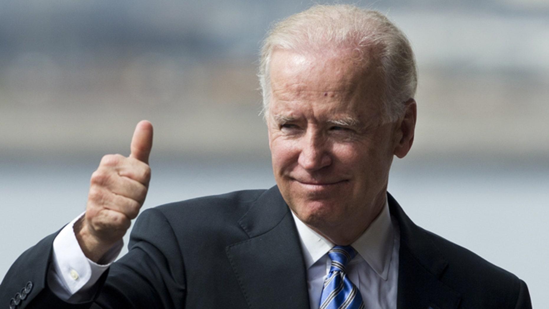 U.S. Vice President Joe Biden gives a thumbs up after giving a speech in Rio de Janeiro, Brazil, Wednesday, May 29, 2013.