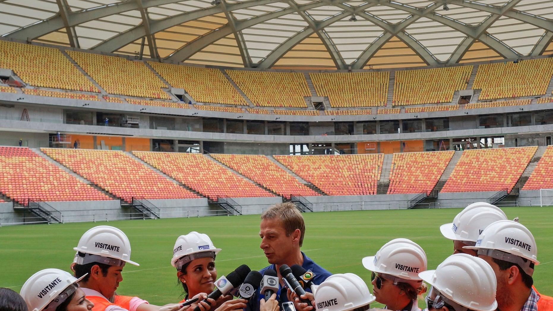 Jan. 24, 2014: Head coach of the United States soccer team, Jurgen Klinsmann, from Germany, talks with the press inside Arena da Amazonia stadium in Manaus, Brazil.