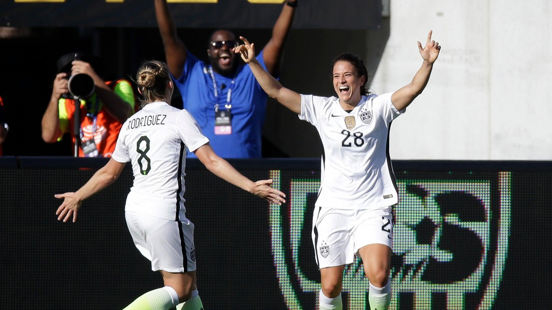 United States' Stephanie McCaffrey (28) celebrates her goal against Brazil with teammate Amy Rodriguez (8) during the second half of an international friendly soccer match Sunday, Oct. 25, 2015, in Orlando, Fla. The United States won 3-1. (AP Photo/John Raoux)