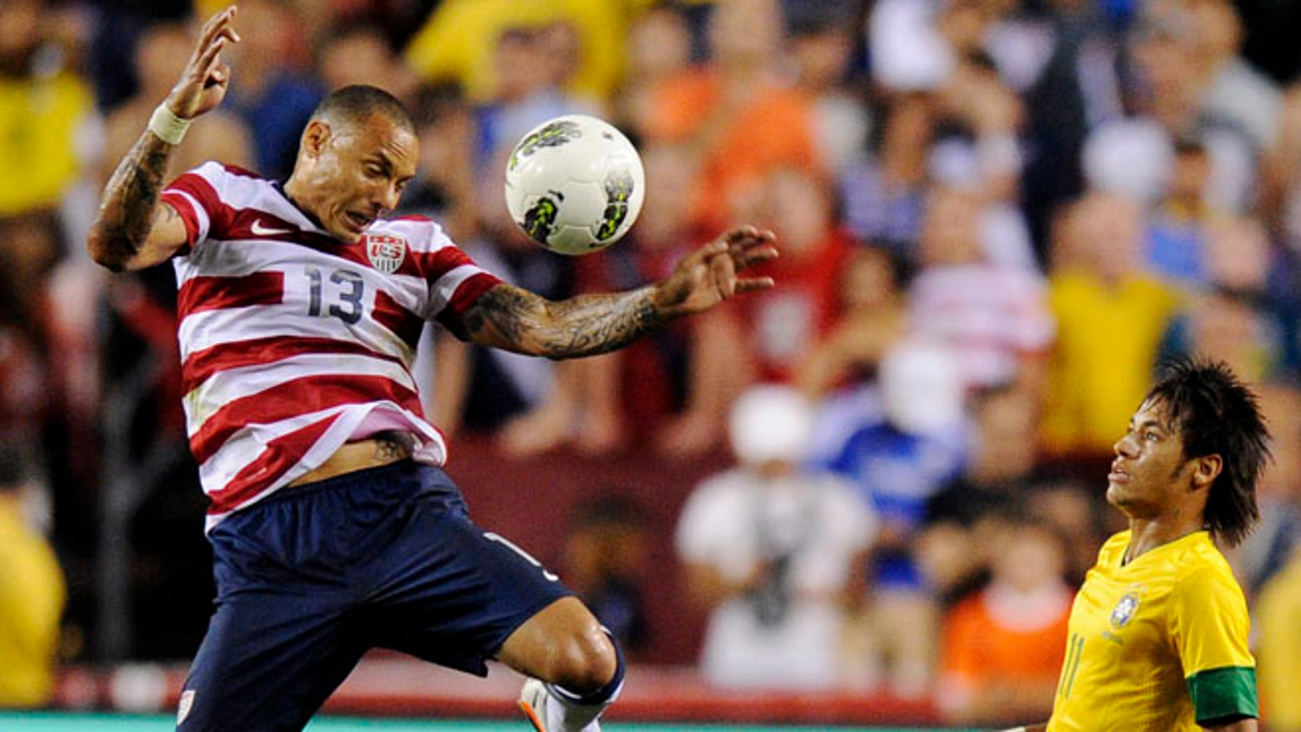 United States' Jermaine Jones (13) goes for the ball as Brazil's Neymar (11) watches, Wednesday, May 30, 2012, in Landover, Md. Brazil won 4-1. (AP Photo/Nick Wass)