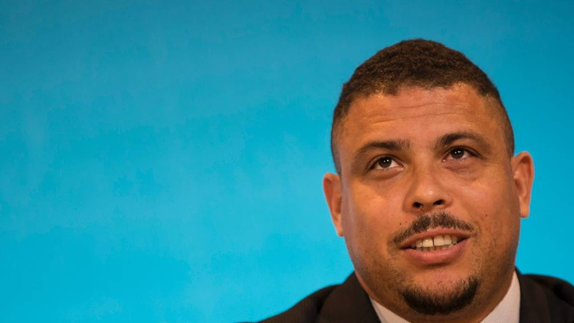 Ronaldo, Brazil's former soccer player and a member of the local organizing committee for the 2014 World Cup, talks during a news conference at the Maracana stadium in Rio de Janeiro, Brazil, Thursday, March 27, 2014. (AP Photo/Felipe Dana)